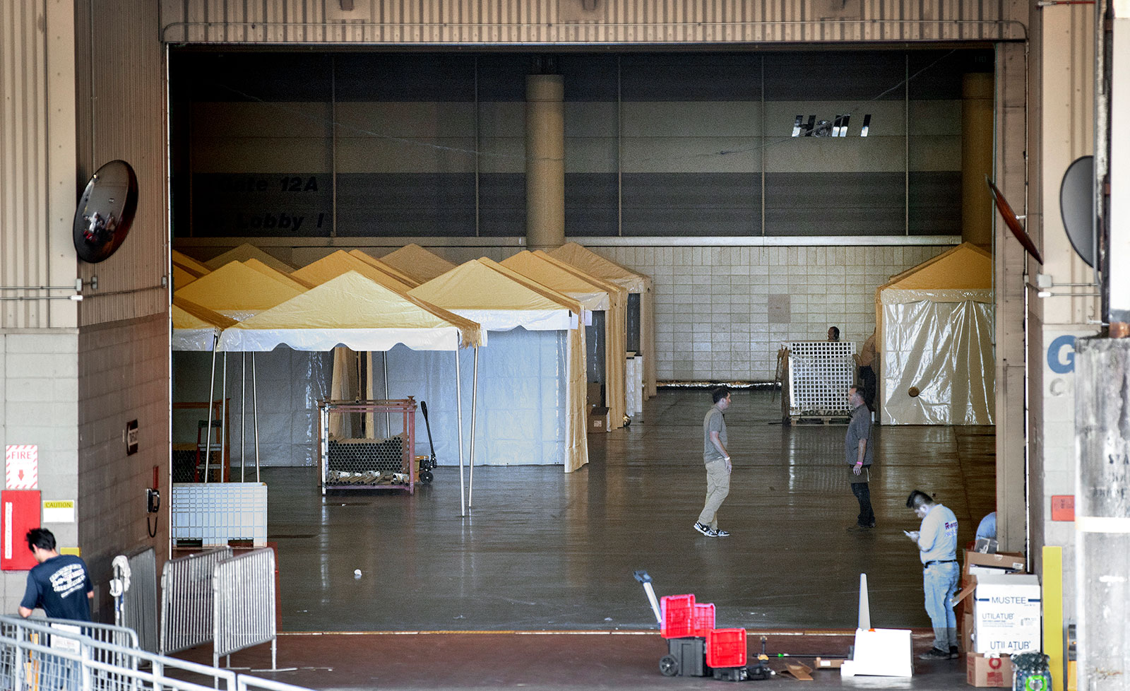 Workers convert the Ernest N. Morial Convention Center into a temporary hospital on Friday, March 27, in New Orleans, Louisiana.