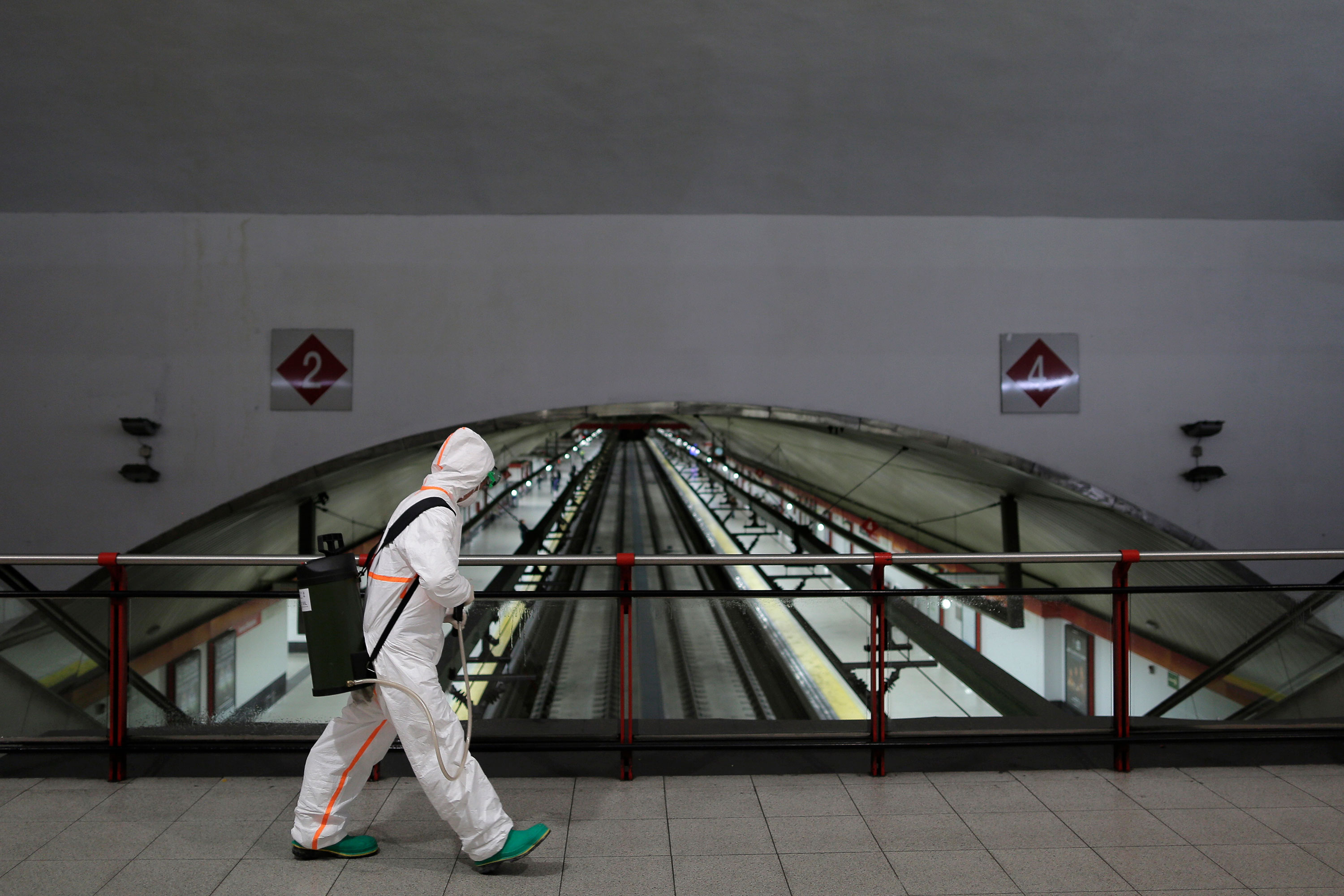 A military member disinfects Nuevos Ministerios subway station in Madrid on March 20.