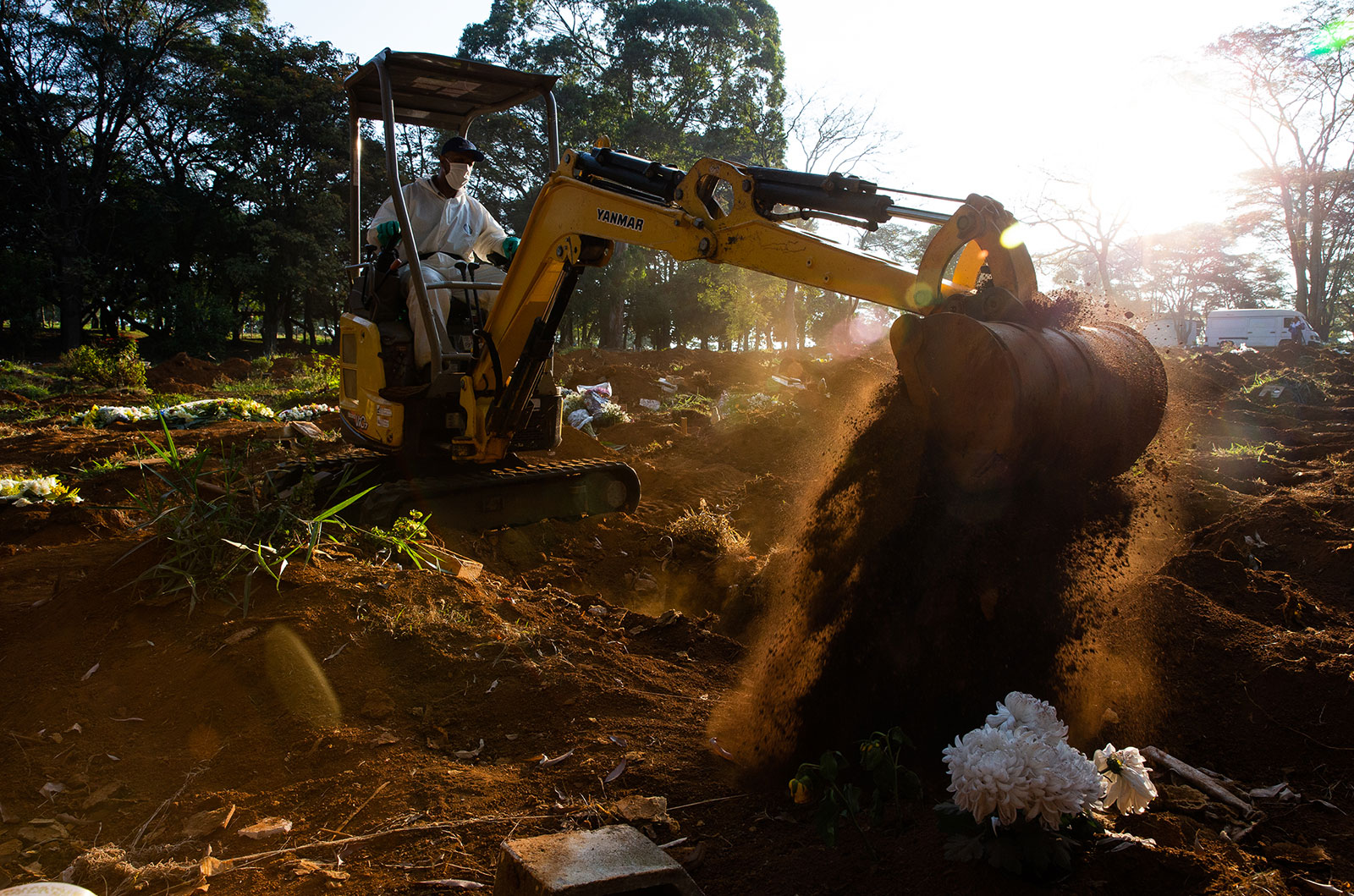 Adenilson Souza Costa digs a grave at Vila Formosa Cemetery in Sao Paulo, Brazil, on May 18.