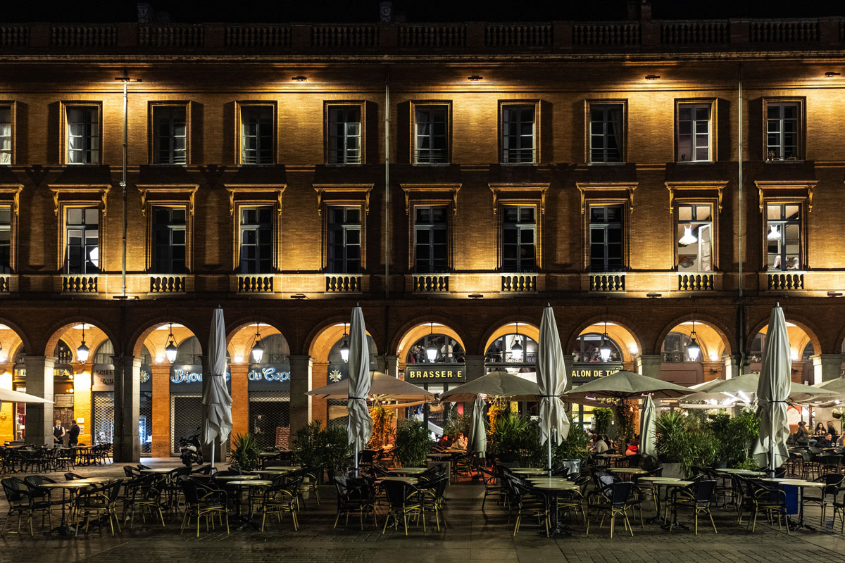 Street lights illuminate vacant tables and chairs on a restaurant terrace ahead of a curfew in Toulouse, France, on October 19.