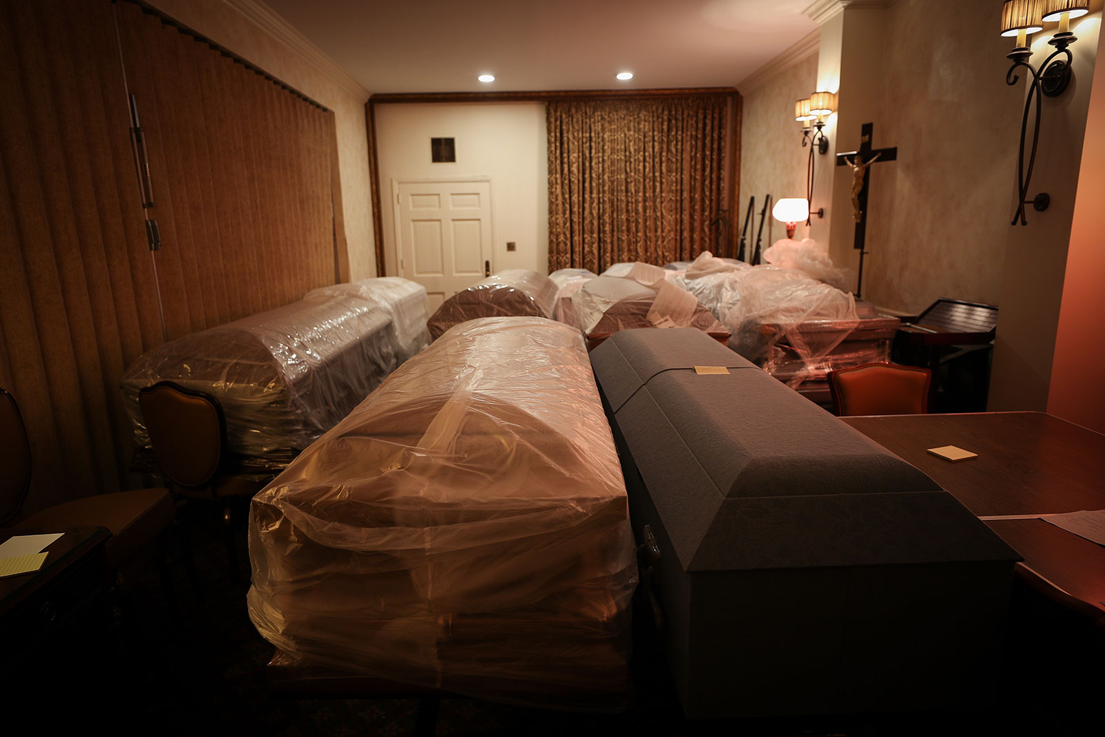 Caskets holding coronavirus victims are seen at the Gerard J. Neufeld funeral home in Queens, New York, on April 29.