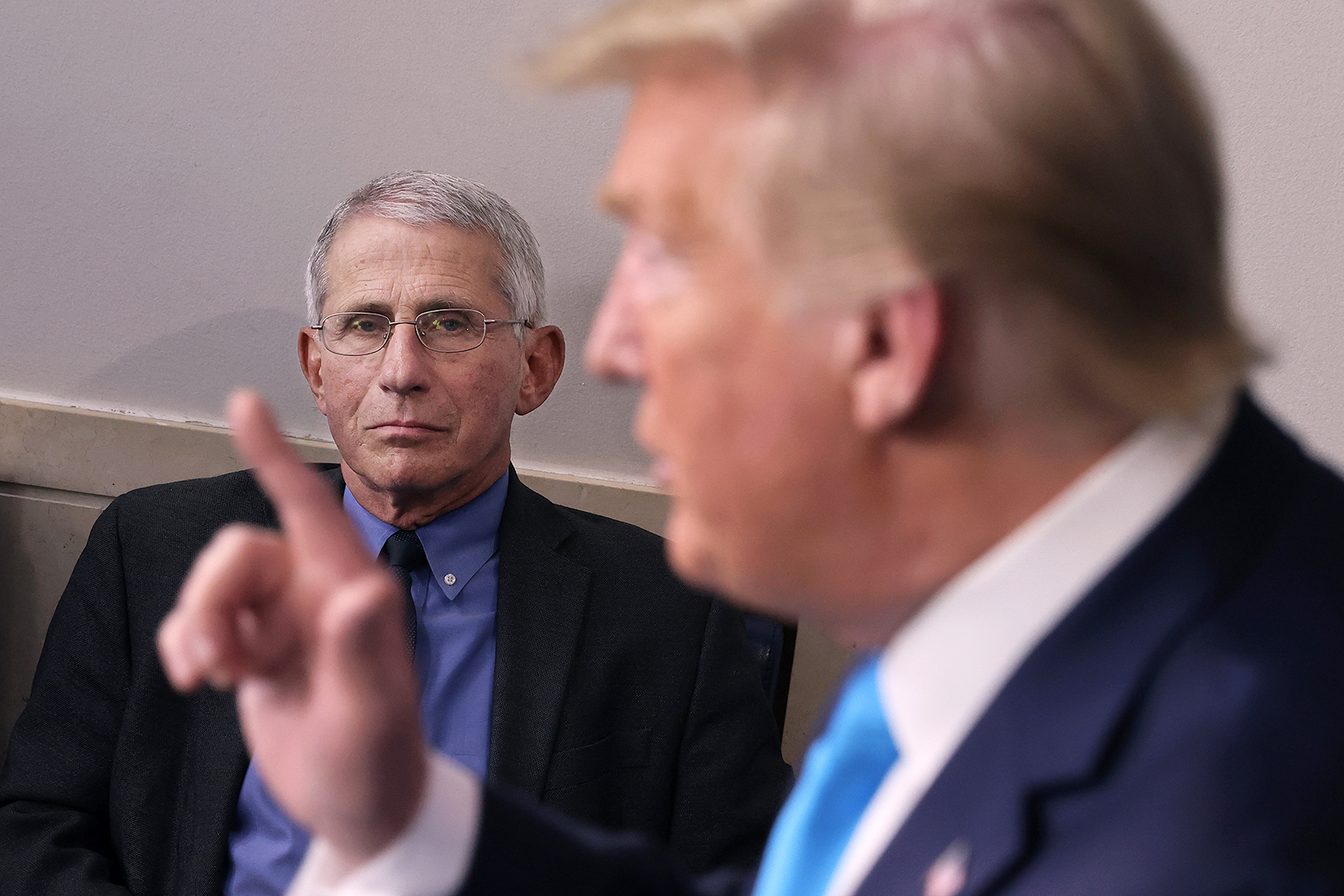 Dr. Anthony Fauci, director of the National Institute of Allergy and Infectious Diseases, listens to President Donald Trump speak to reporters at the White House in Washington, DC, on April 7, 2020.