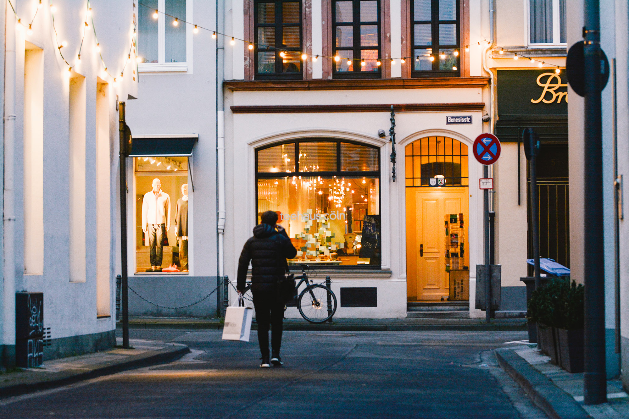 A shopper walks in a nearly empty street in Cologne, Germany on January 5, 2021.