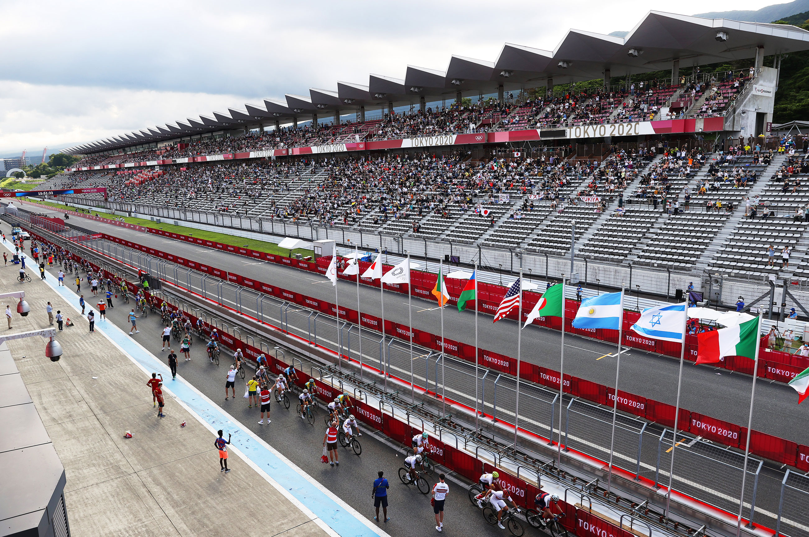 The peloton passes through the Fuji International Speedway circuit during the Men's road race on July 24.