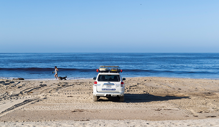 Lifeguards keep a lookout at Laguna Beach, California after officials reopened access to the sand on Tuesday, May 5. The beach has been closed since March 23. City parks along the beach are still closed and people cannot sit or linger on the sand.