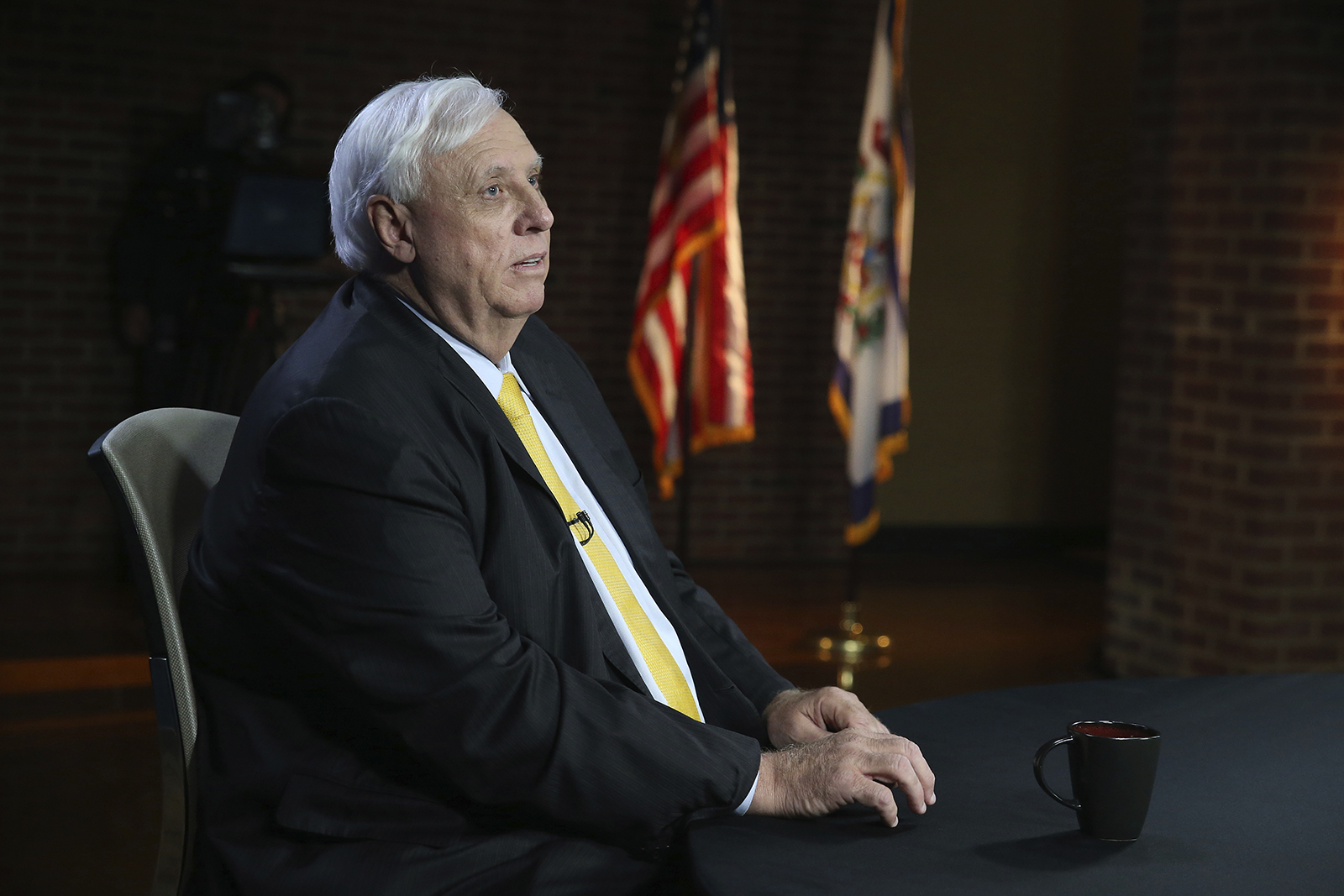 West Virginia Gov. Jim Justice prepares for a debate with Democratic challenger, Kanawha County Commissioner Ben Salango in Morgantown, West Virginia, on Tuesday, October 13.