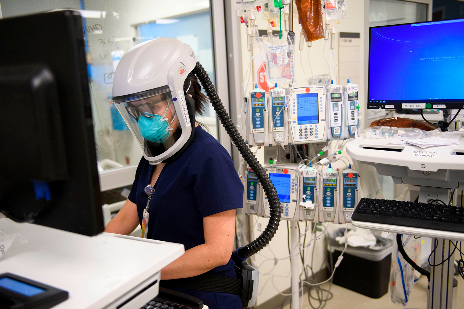 A nurse wearing personal protective equipment works in a Covid-19 intensive care unit at Martin Luther King Jr. Community Hospital on January 6, in the Willowbrook neighborhood of Los Angeles.