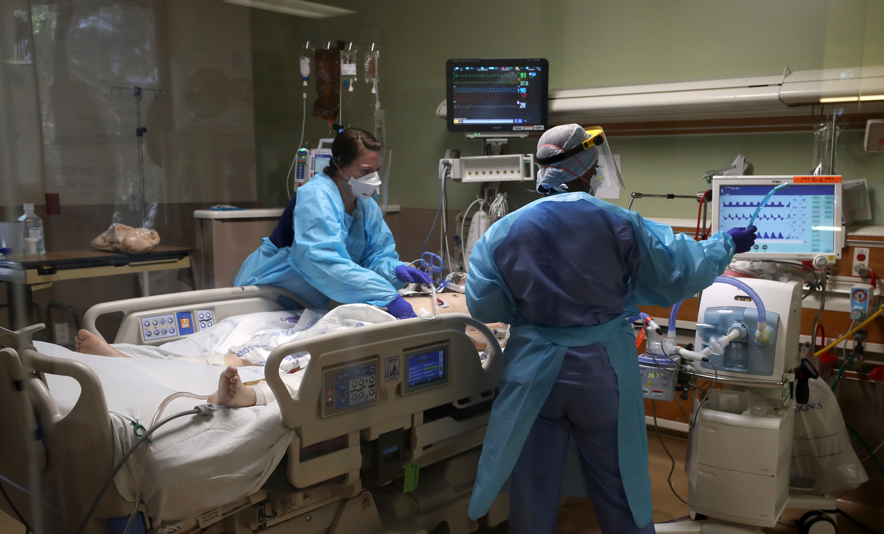 Nurses care for a coronavirus patient in the intensive care unit at Regional Medical Center in San Jose, California, on May 21.
