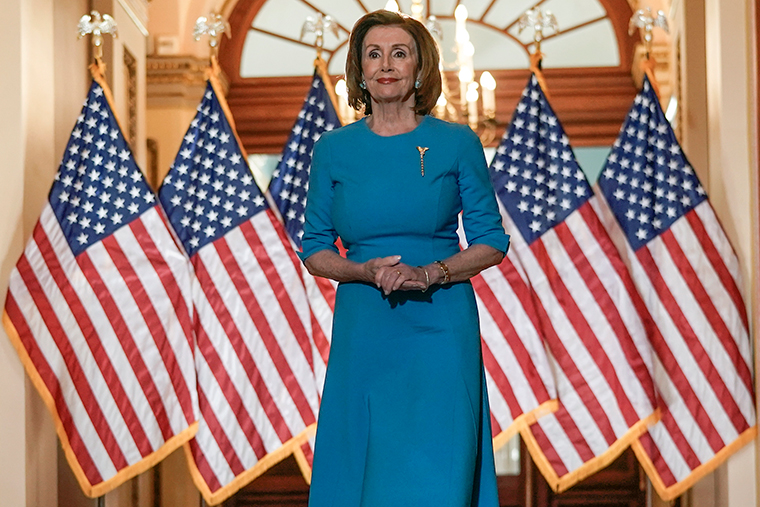 House Speaker Nancy Pelosi arrives earlier on Friday, March 13,  to speak about the House coronavirus bill on Capitol Hill.