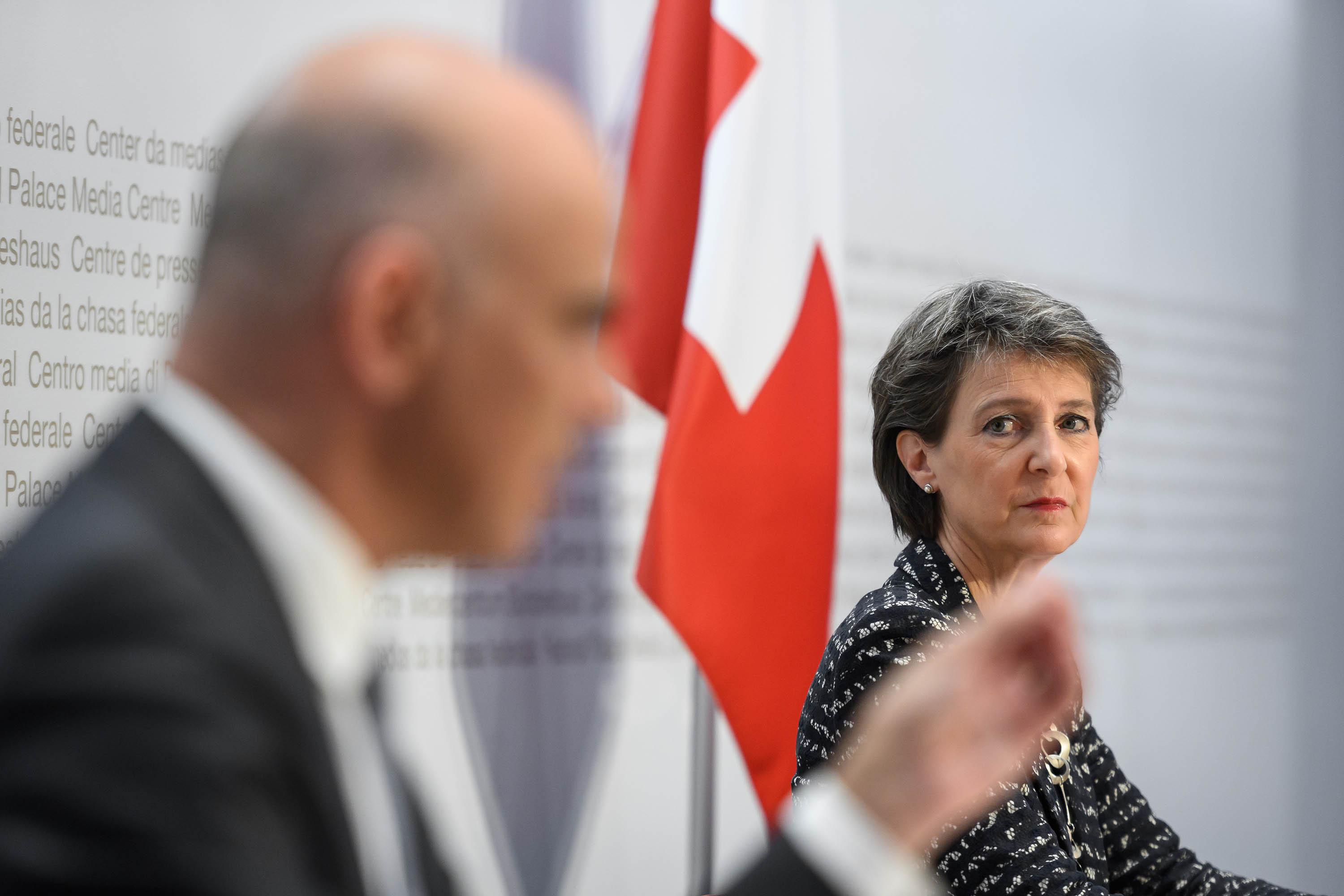 Swiss President Simonetta Sommaruga, right, looks on as Swiss Interior and Health Minister Alain Berset speaks during a press conference announcing new measures against the coronavirus in Bern on Sunday.