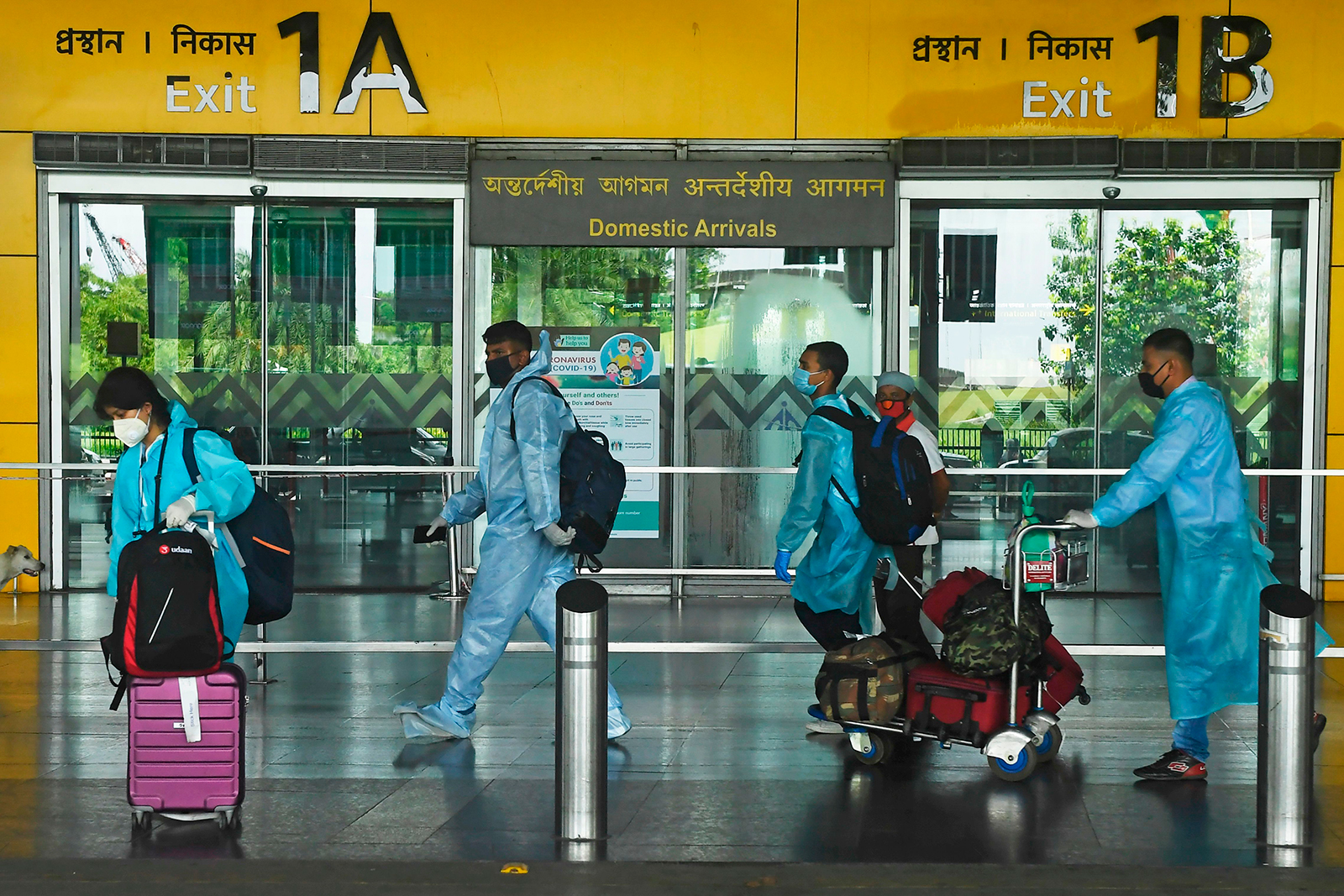 Air passengers wearing protective suits at Netaji Subhas Chandra Bose International Airport in Kolkata, India on July 6.