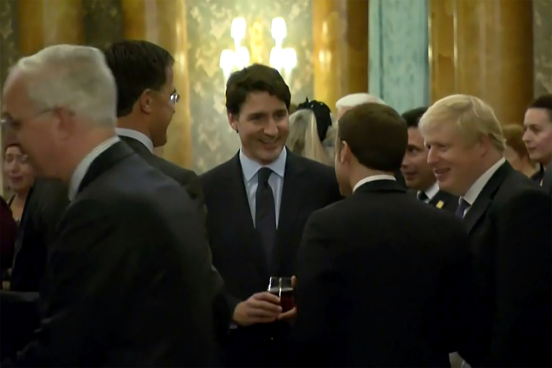 In this grab made from video, Canada's Prime Minister Justin Trudeau  speaks with Dutch Prime Minister Mark Rutte, left, French President Emmanuel Macron, second from right, and British Prime Minister Boris Johnson, right, during an event at a Buckingham Palace on December 3. Photo: NATO TV/AFP via Getty Images