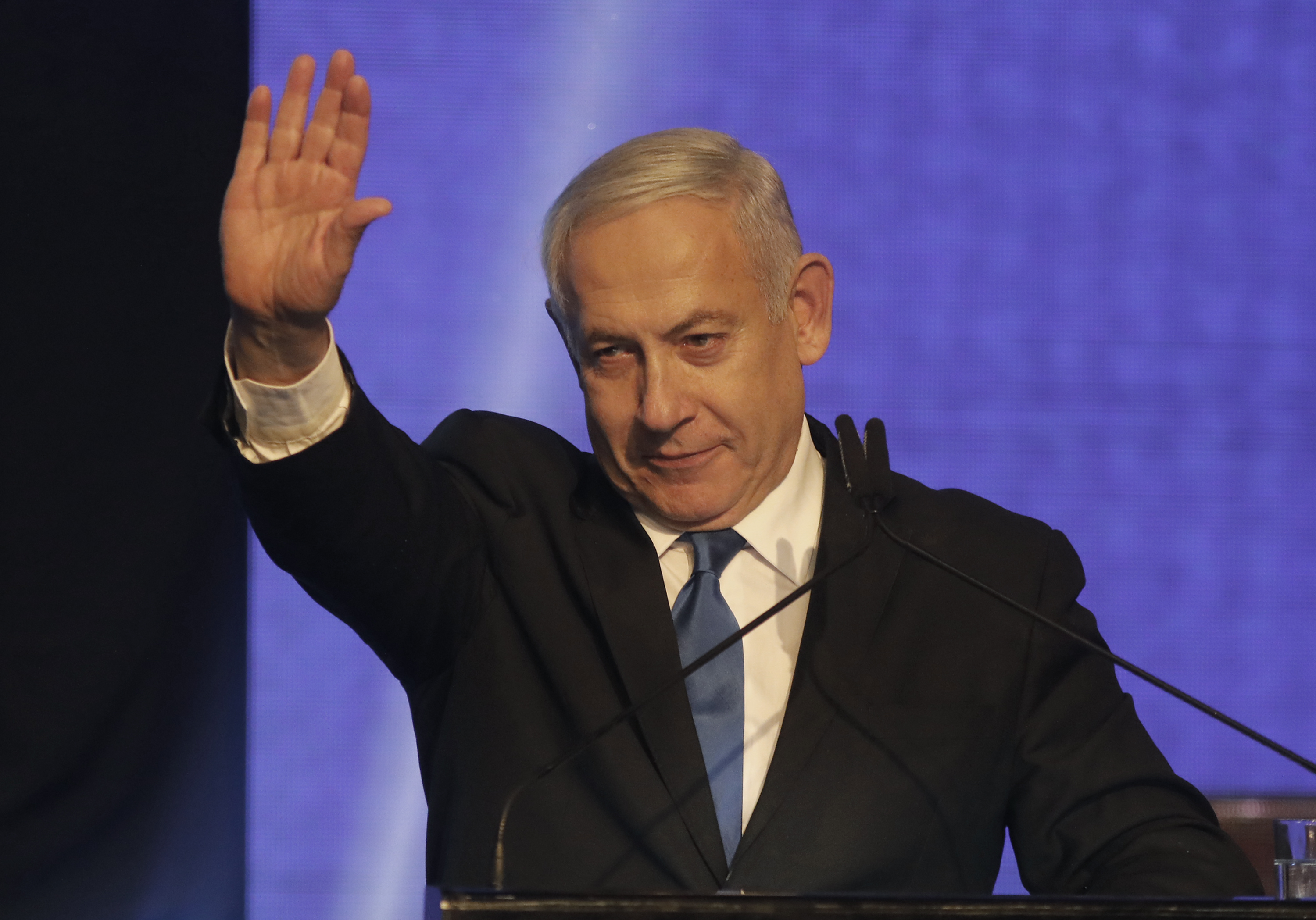 Israeli Prime Minister Benjamin Netanyahu addresses supporters at his Likud party's electoral campaign headquarters early on September 18, 2019.