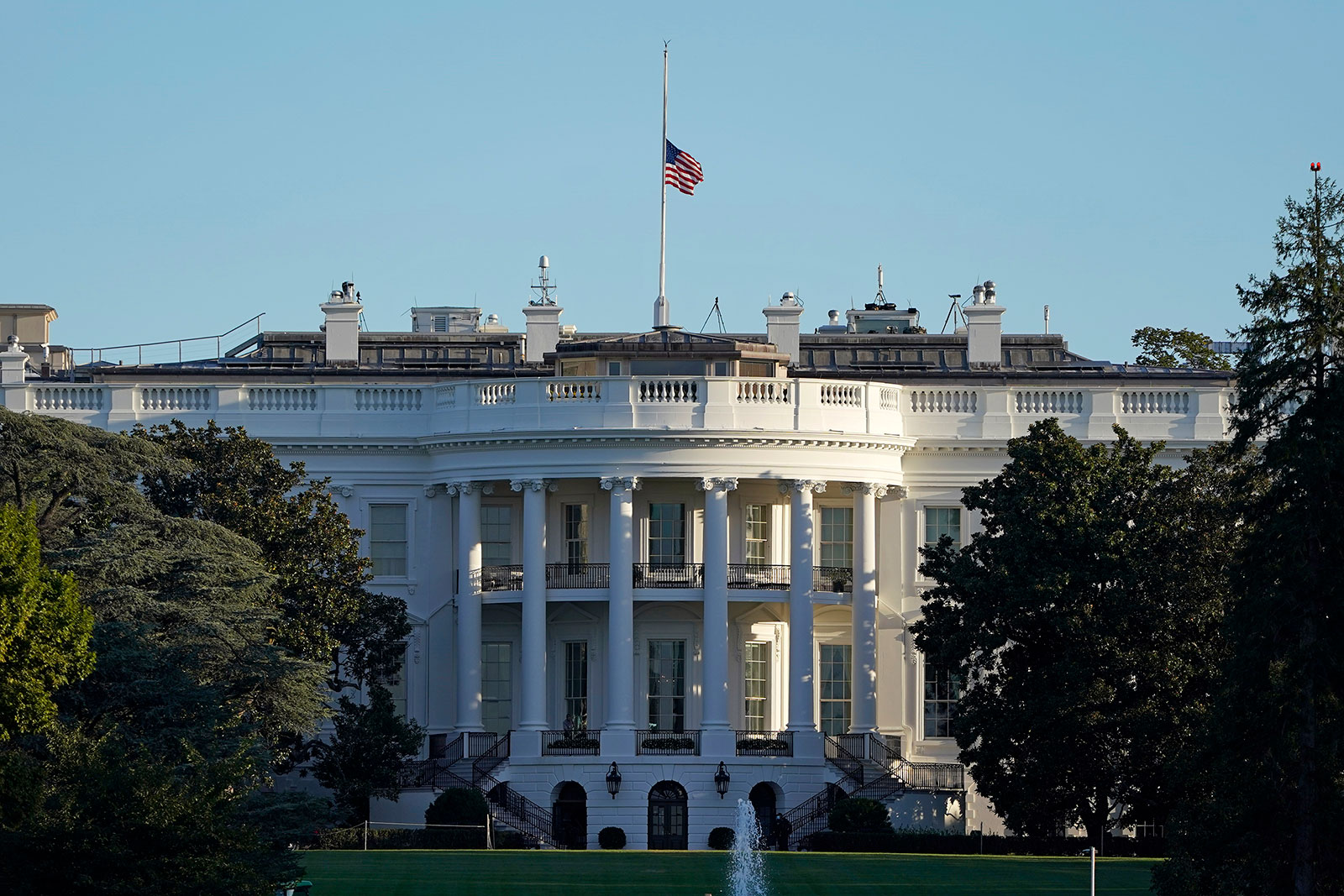 The American flag flies at half-staff above the White House on Saturday.