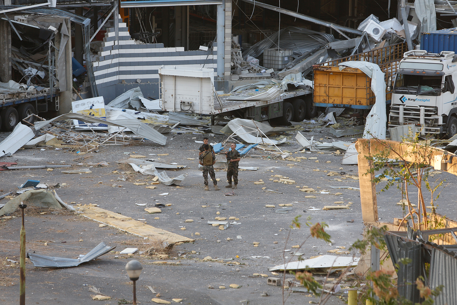 Military personnel stand amid debris on August 5, in Beirut, Lebanon.
