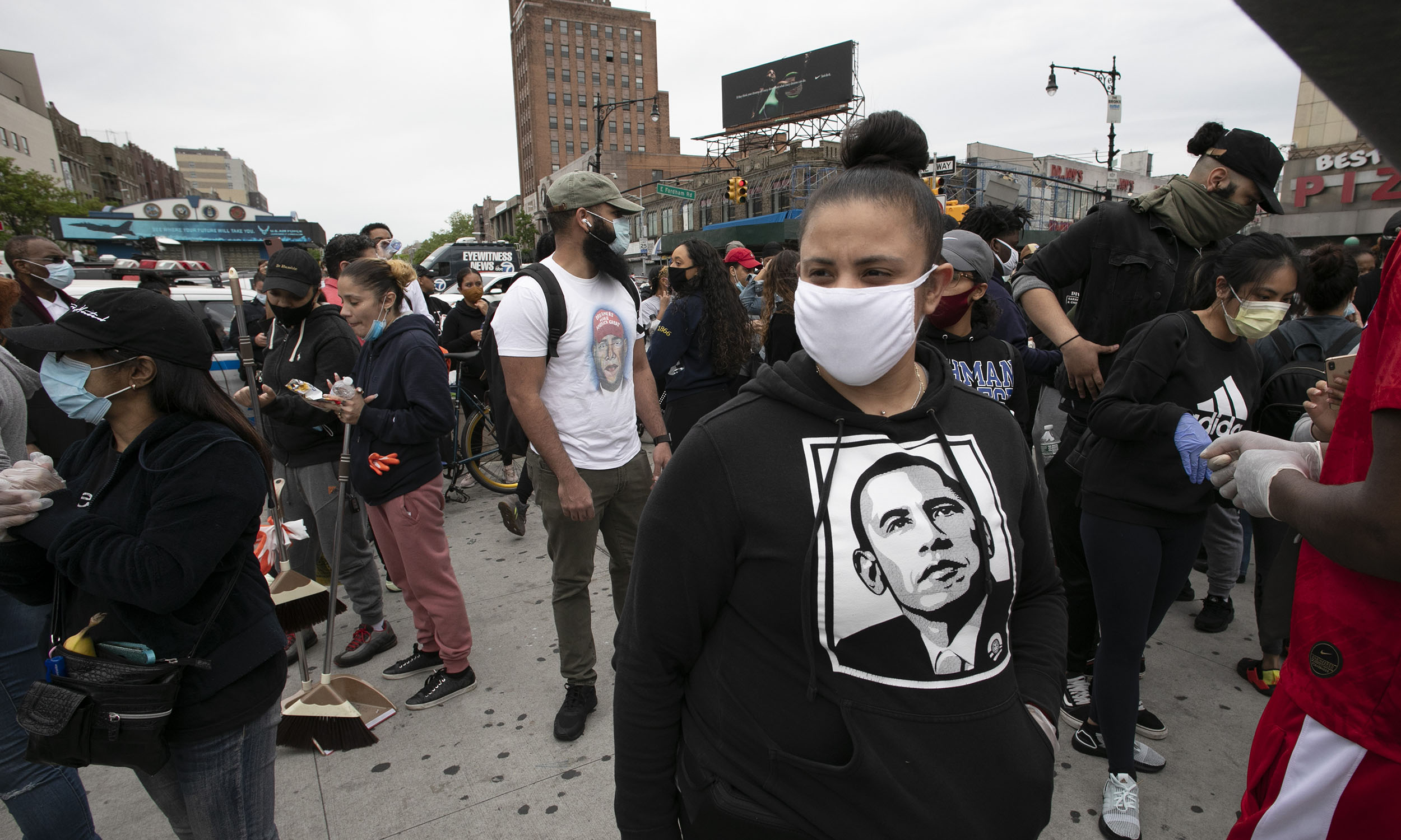 Sidnoma Ouango wears a President Barack Obama sweat shirt during a community effort to help store owners clean up in Bronx, New York, on Tuesday, June 2.