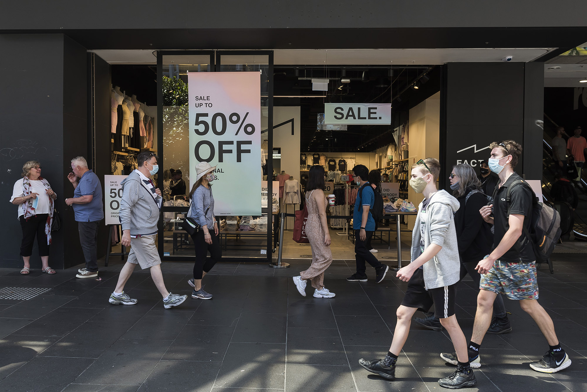 Shoppers walk along Bourke Street Mall during Boxing Day sales on December 26, in Melbourne, Australia.