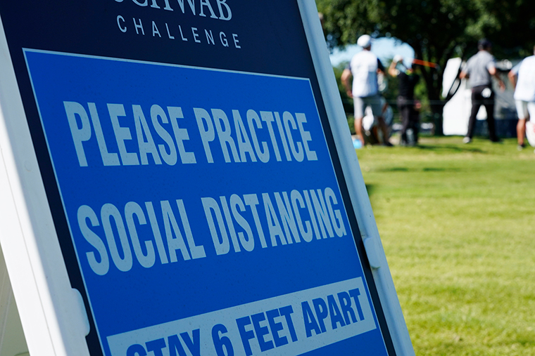 A sign at the 17th tee reminds players to practice social distancing during the first round of the Charles Schwab Challenge golf tournament at the Colonial Country Club in Fort Worth, Texas, Thursday, June 11.