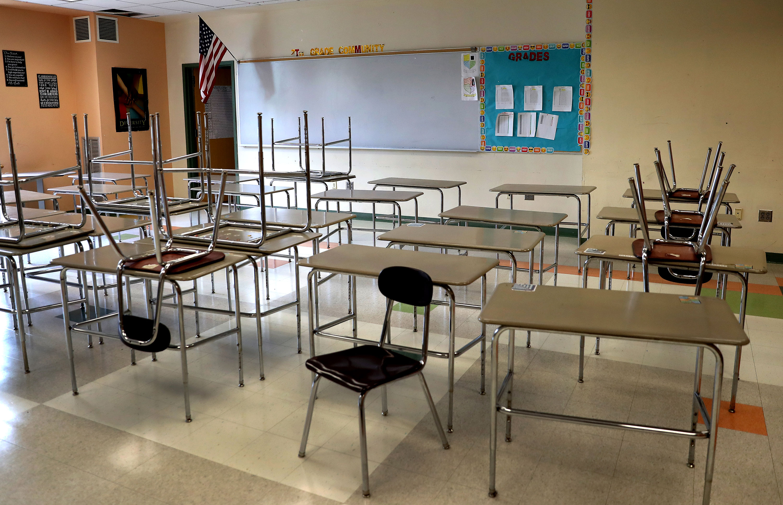 An empty classroom is seen inside the Mildred Avenue K-8 School building on July 9 in Boston.