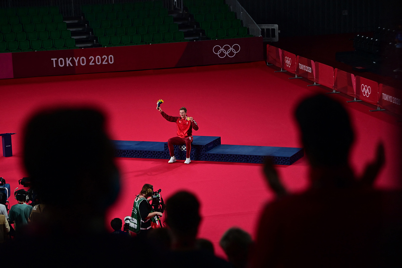 Denmark's Viktor Axelsen waves to the crowd during a medal ceremony on Monday.