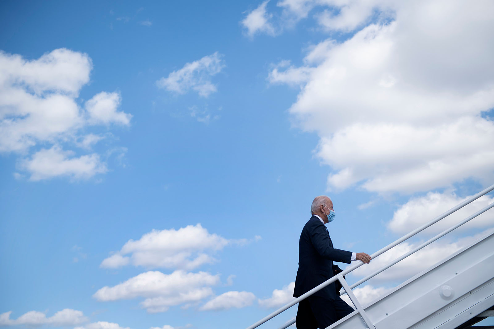 Democratic presidential candidate Joe Biden boards his campaign plane at Wilmington Airport on October 6, in New Castle, Delaware.