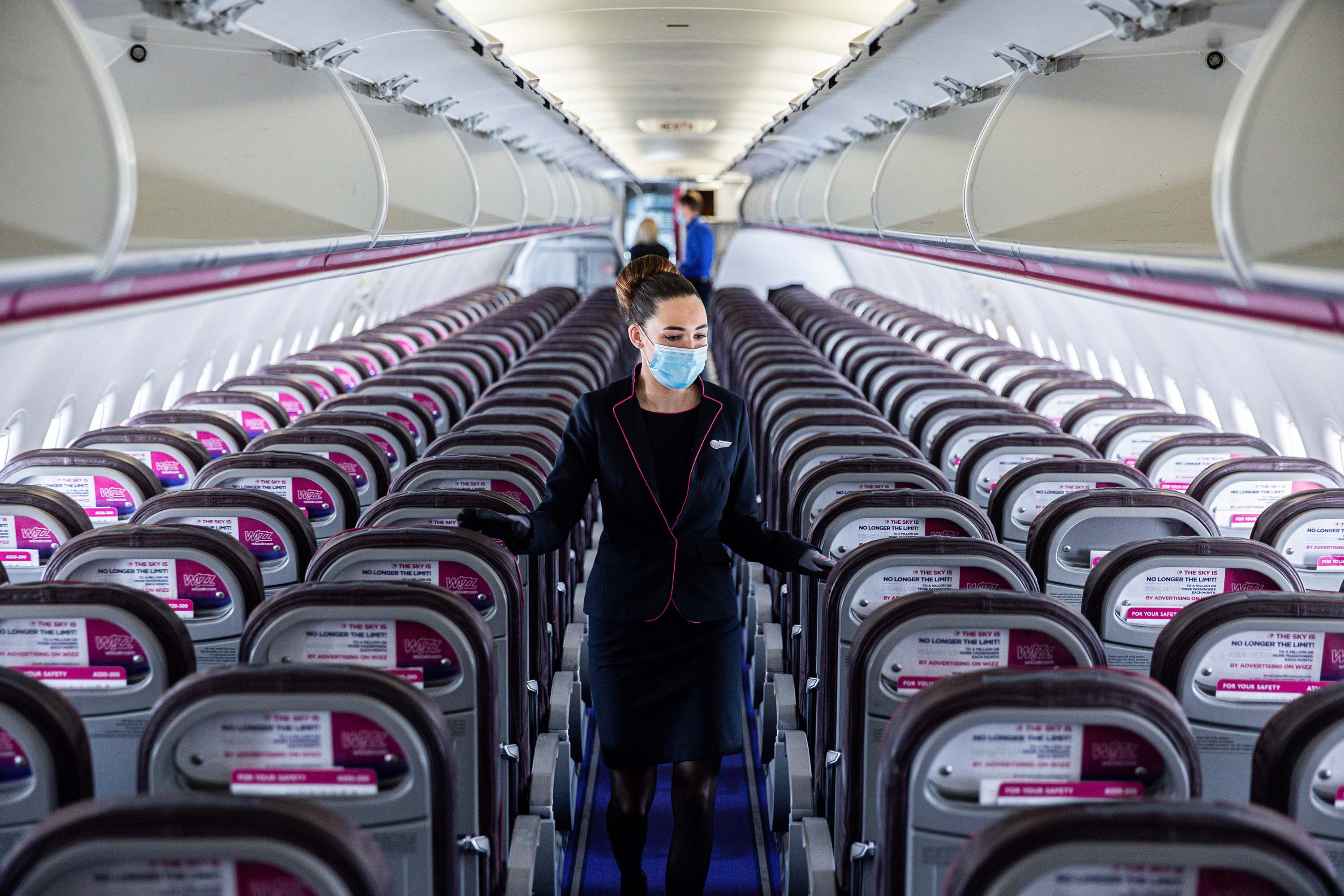 A member of the cabin crew checks cabin seating ahead of a Wizz Air flight at Liszt Ferenc airport in Budapest, Hungary, on May 25.