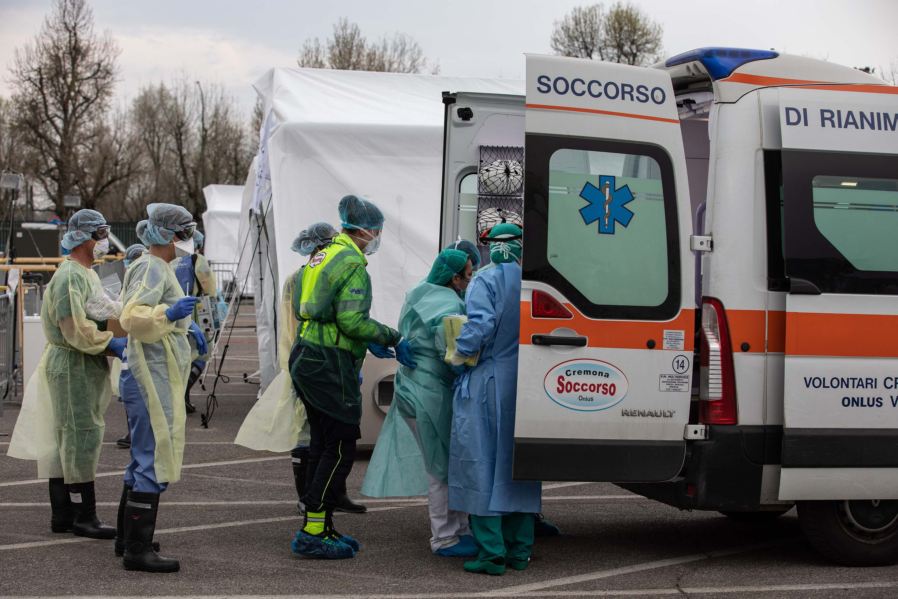 Medical personnel transport a coronavirus patient to a field hospital in Cremona, Italy, on March 20.
