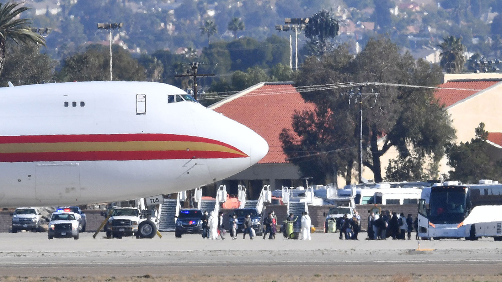 Passengers on a charter flight from Wuhan, China, arrive in Riverside, California, on January 29.