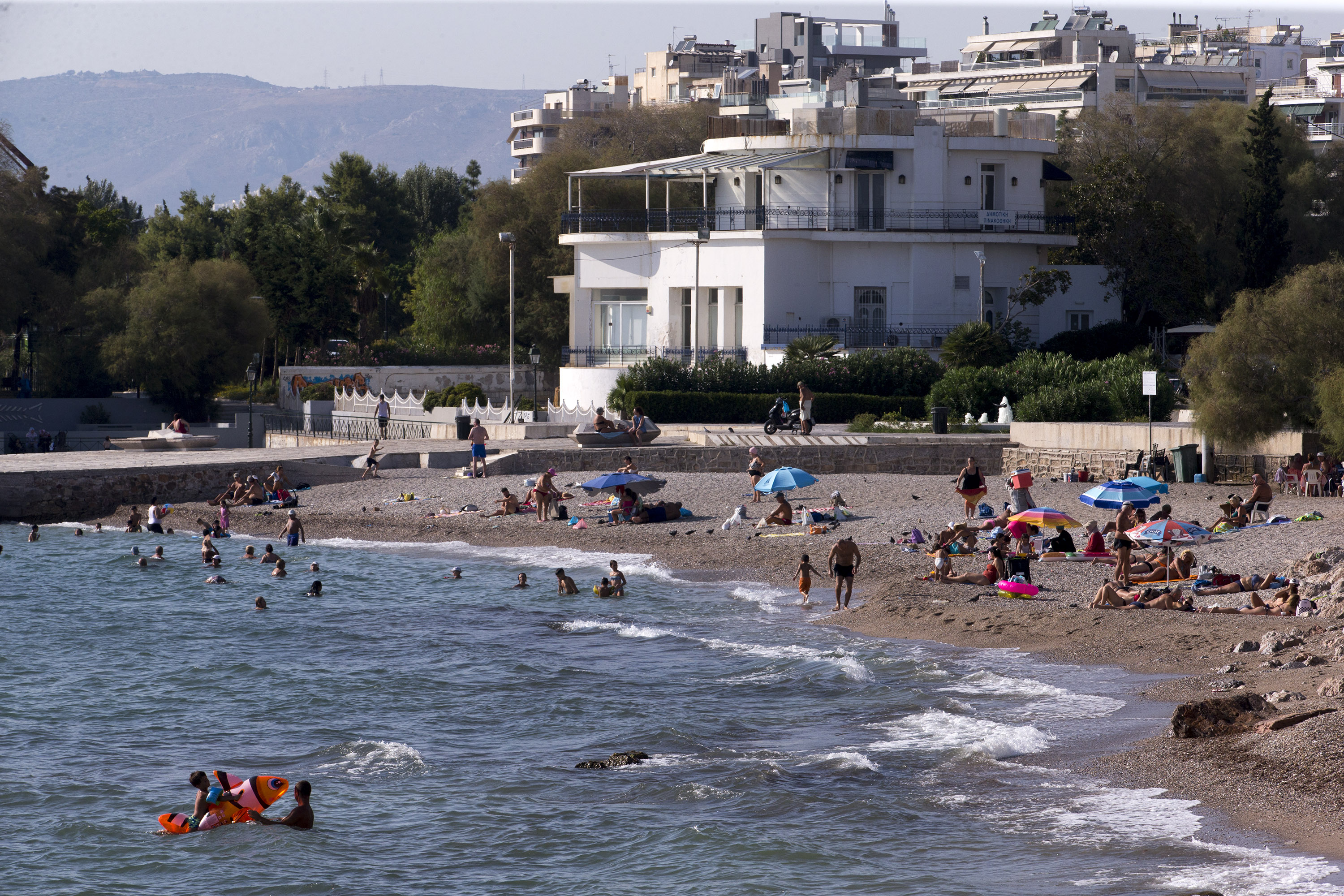 People visit a beach in Athens, Greece, on September 1.