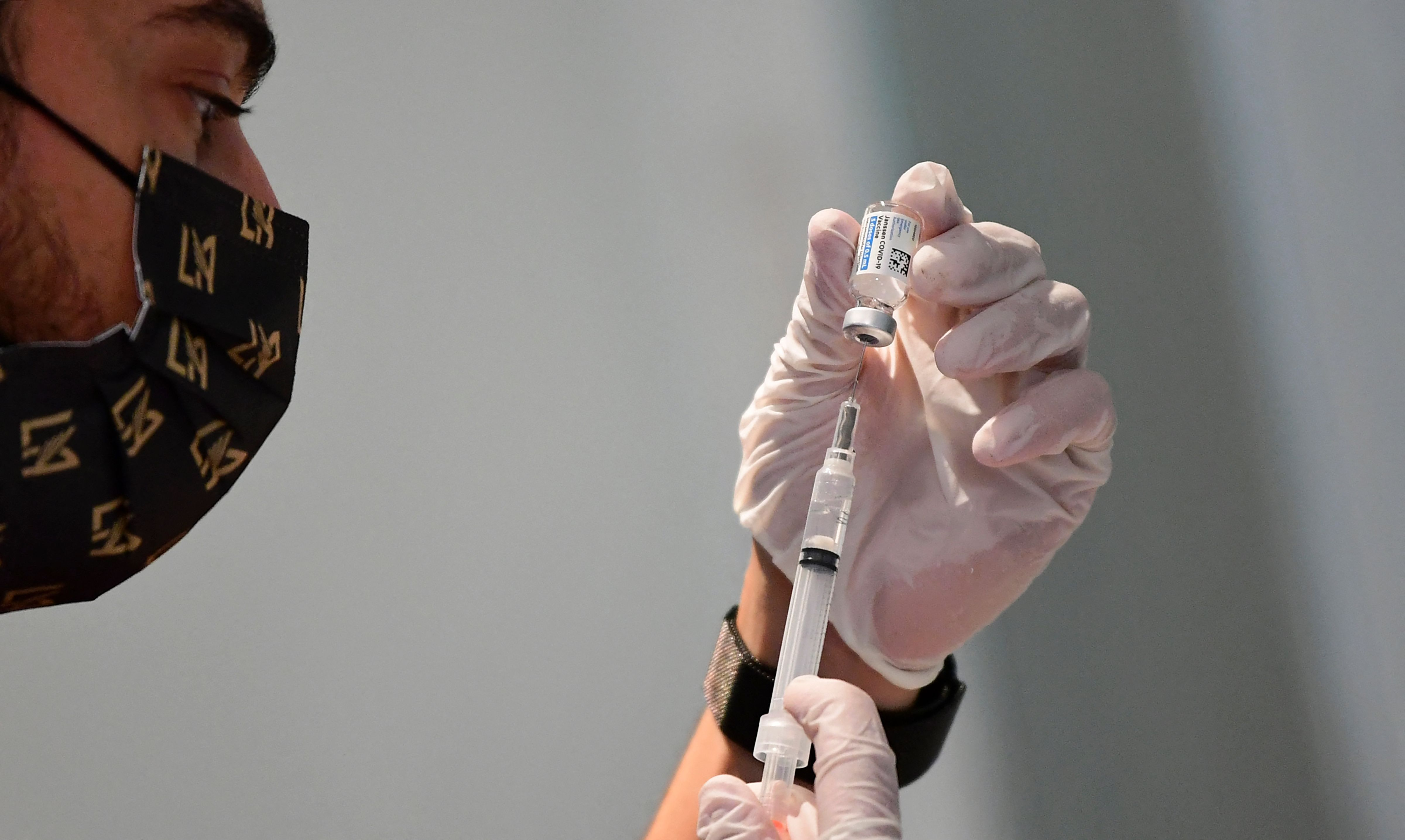 A health care worker prepares a Johnson & Johnson Covid19 vaccine on May 7, in Los Angeles.