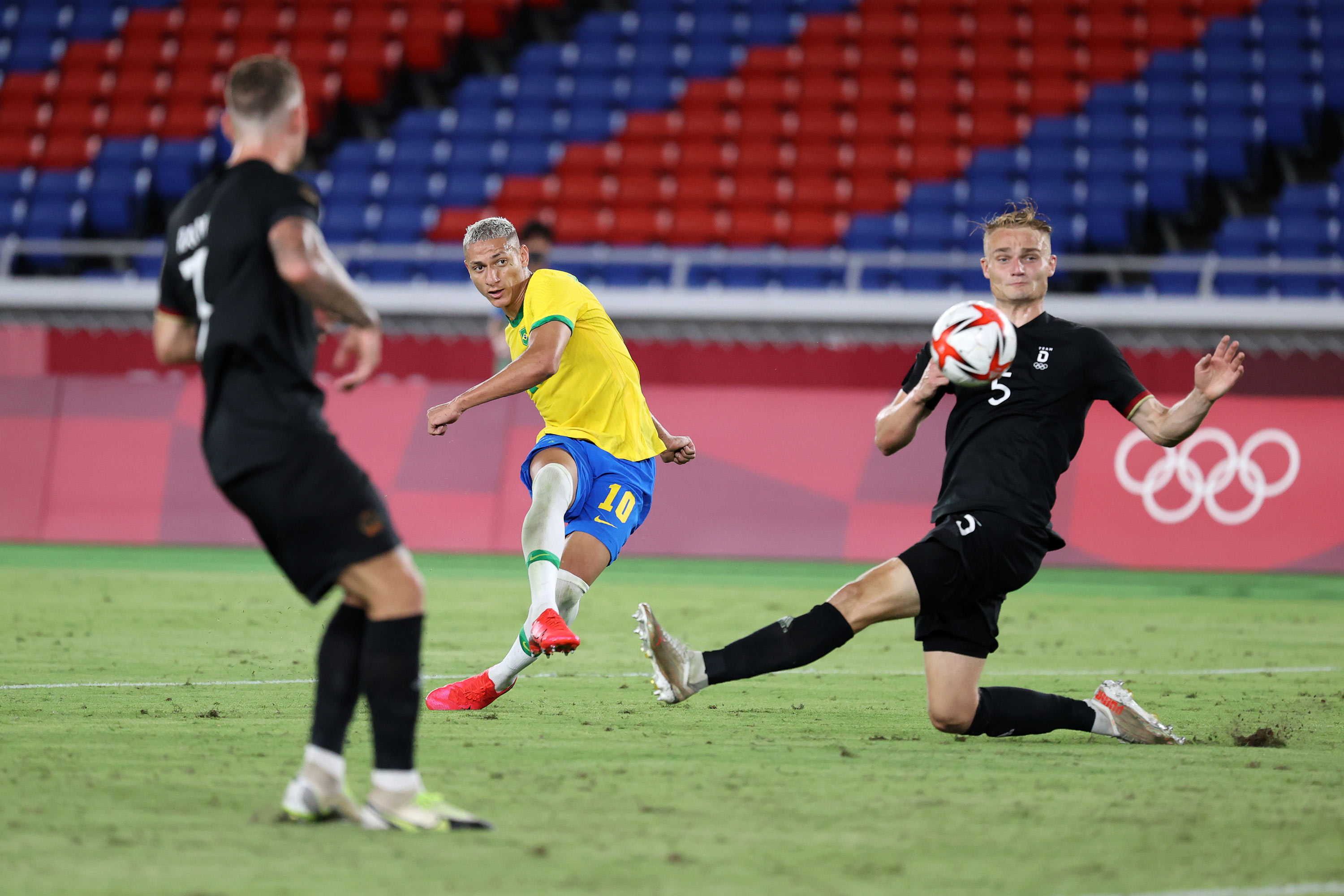 Richarlison of Brazil, center, scores their side's third goal during the First Round Group D match between Brazil and Germany on July 22.