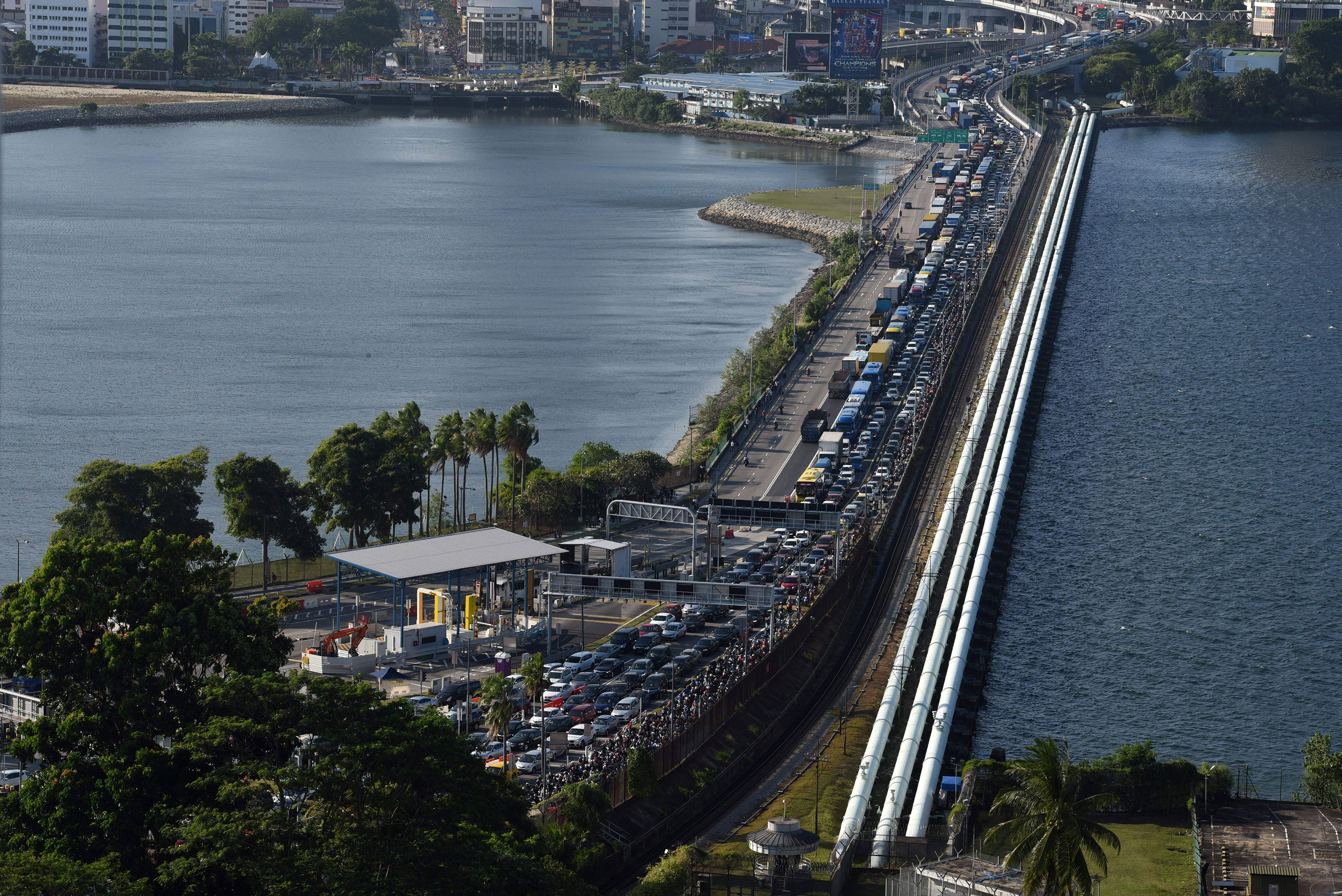 A line of cars waiting to enter Singapore from southern Malaysia forms at the Woodlands checkpoint on March 17.