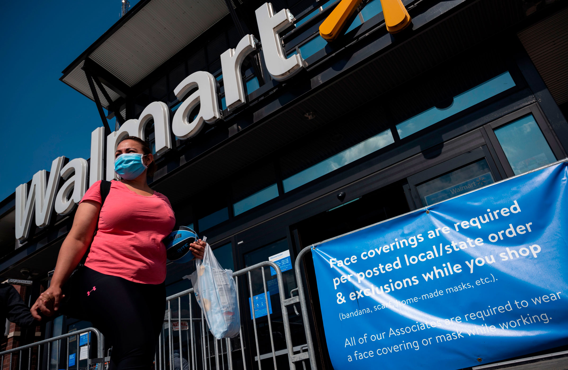 A woman walks outside a Walmart store in Washington, DC, on Wednesday.