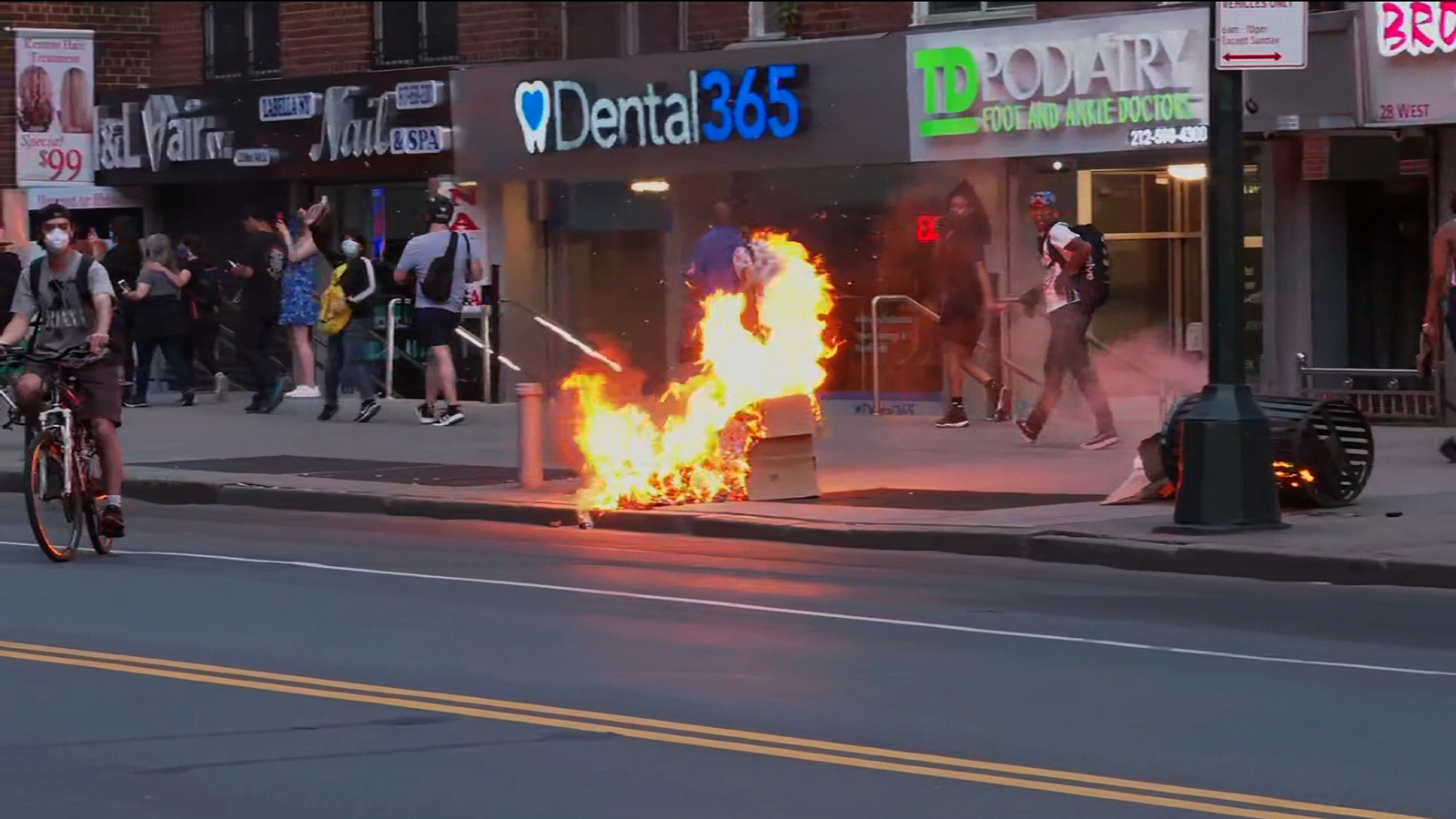 A trash fire ignited by protesters on the street in New York, on May 30.