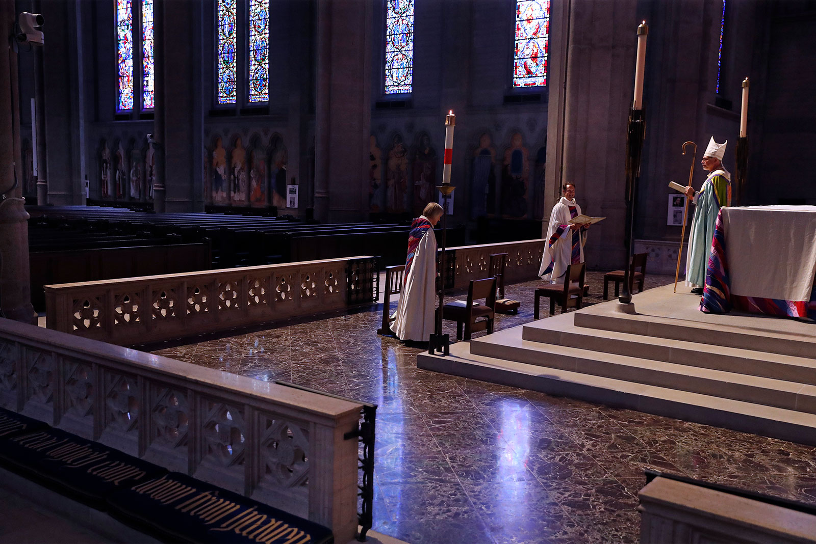 From left, Vice Dean Ellen Clark-King, Dean Malcolm Young and Bishop Marc Andrus conduct a virtual Easter Sunday service at an empty Grace Cathedral in San Francisco, California.