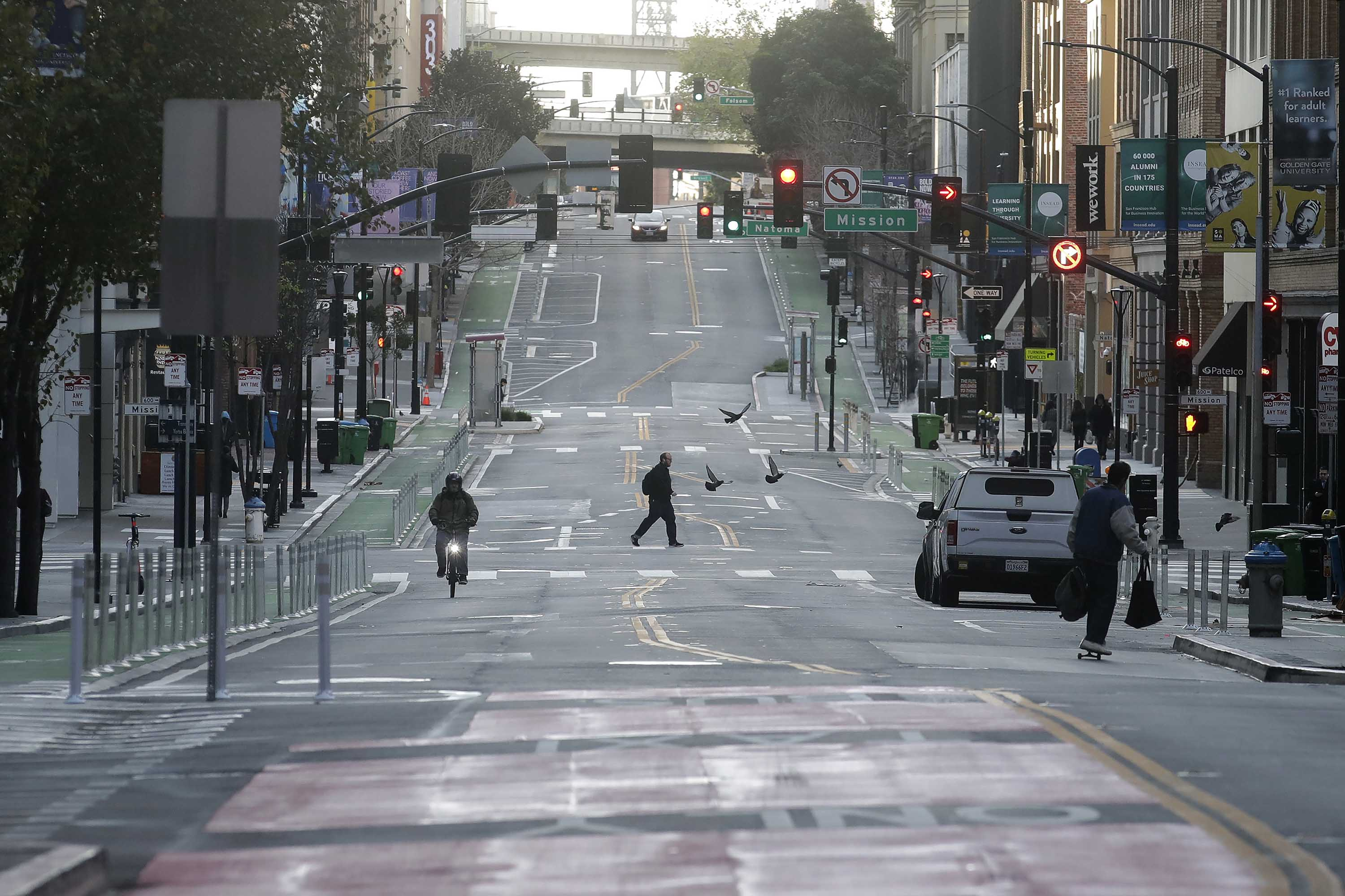 A man crosses a nearly empty street in San Francisco, on March 17.