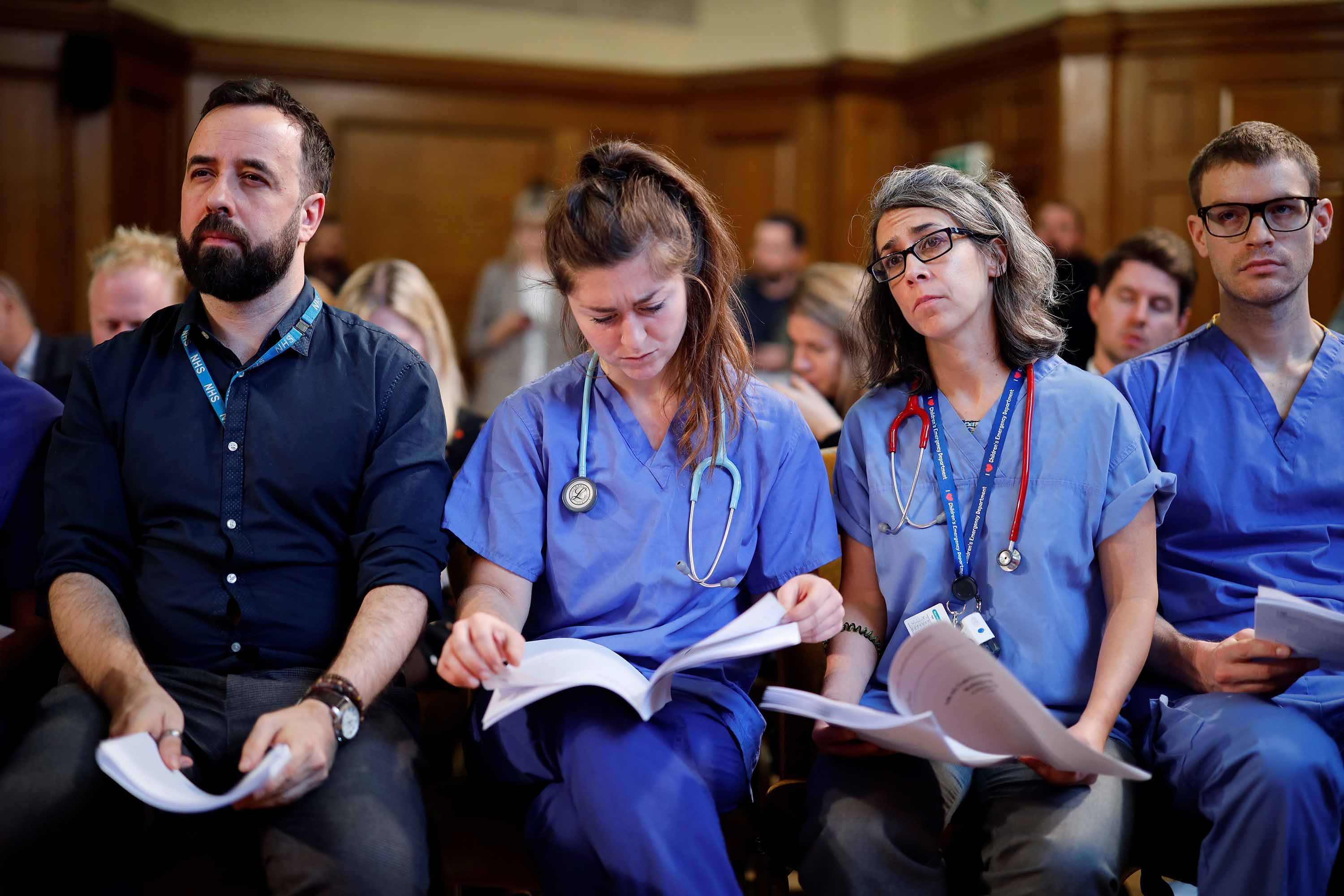 NHS workers read documents about the Conservative government's UK-US trade talks during a press conference by UK opposition Labour party leader Jeremy Corbyn in London on November 27. Photo: Tolga Akmen/AFP via Getty Images