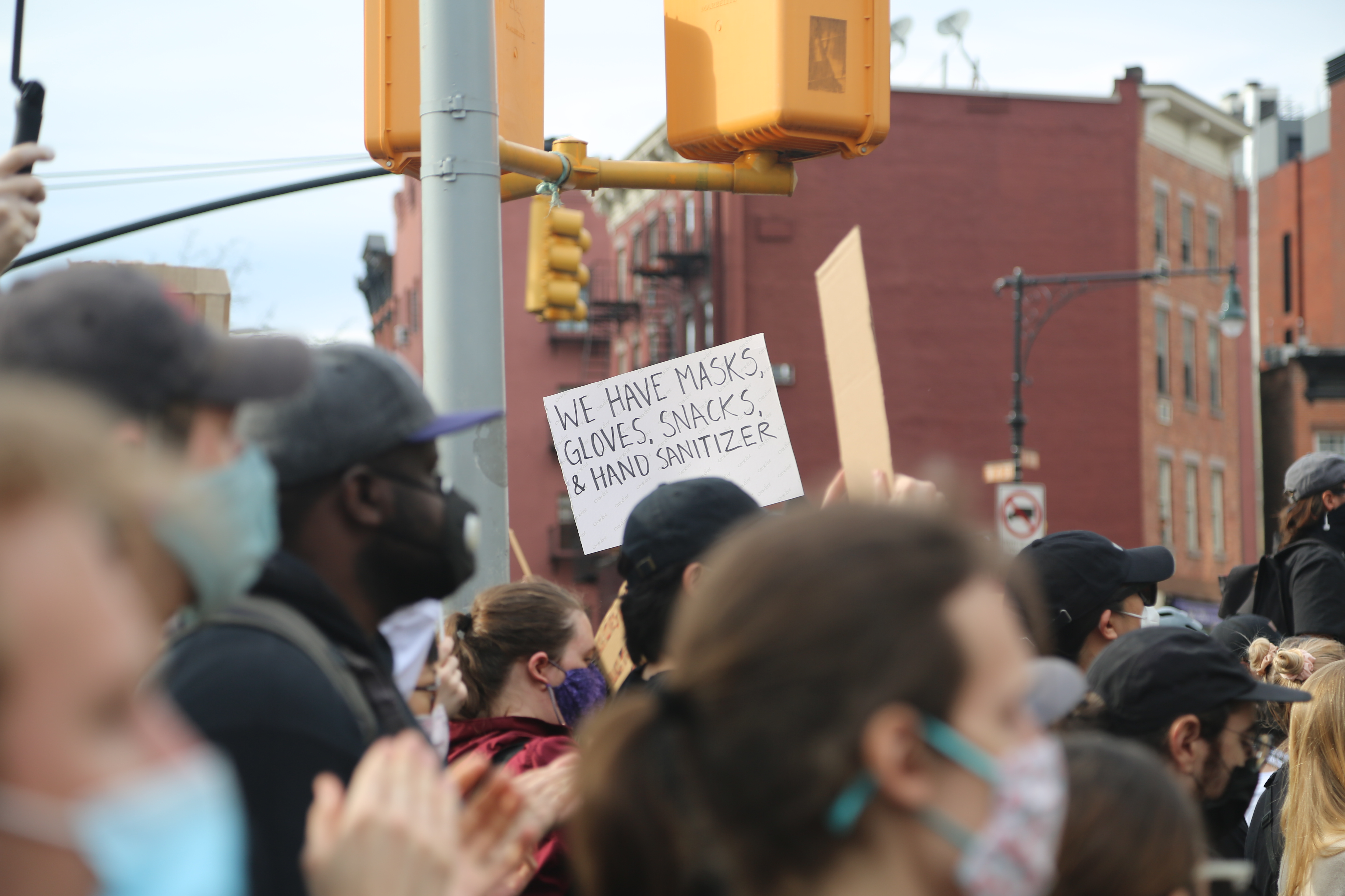 Protesters hold up signs during protests in New York.