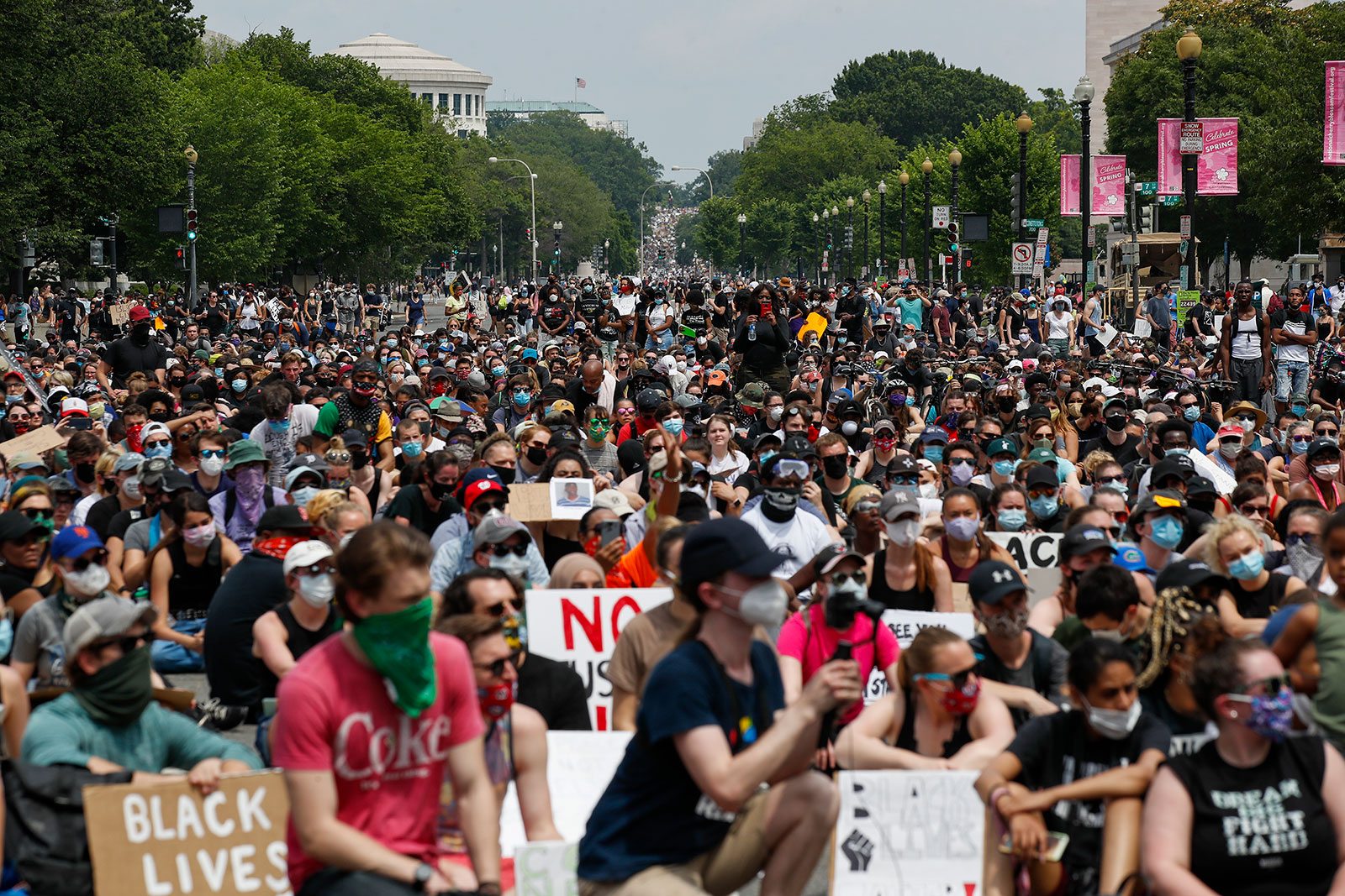 Demonstrators flood the streets of Washington on Saturday, June 6