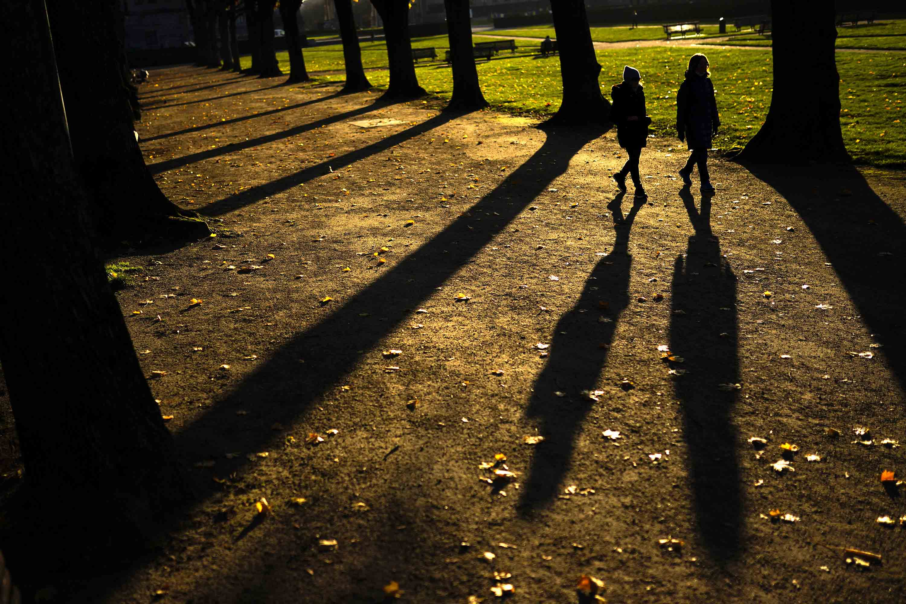 People walk in Cinquantenaire park in Brussels, Belgium, on November 20.