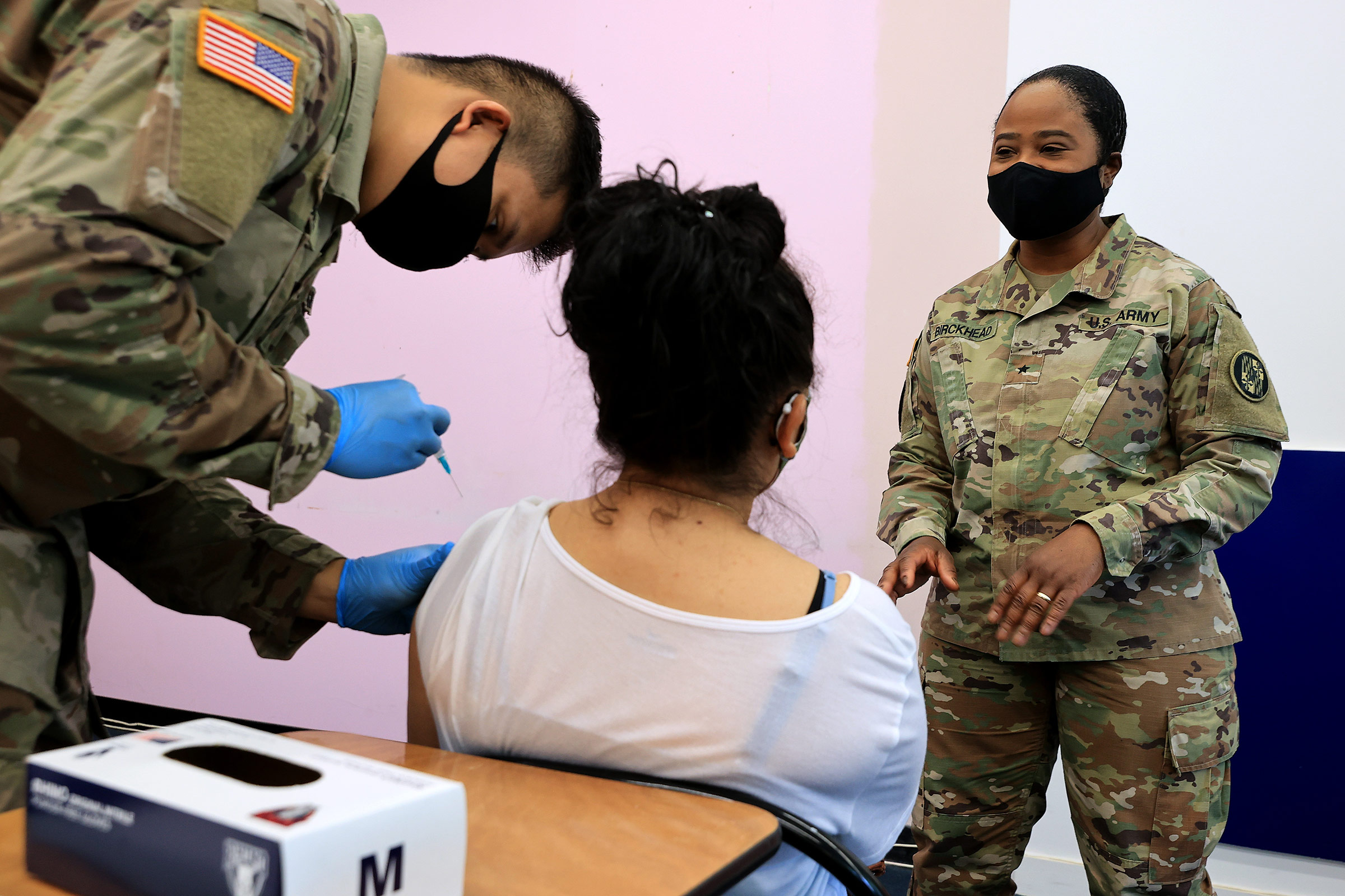 A member of the Maryland National Guard administers a dose of the Moderna coronavirus vaccine on May 21, in Wheaton, Maryland.