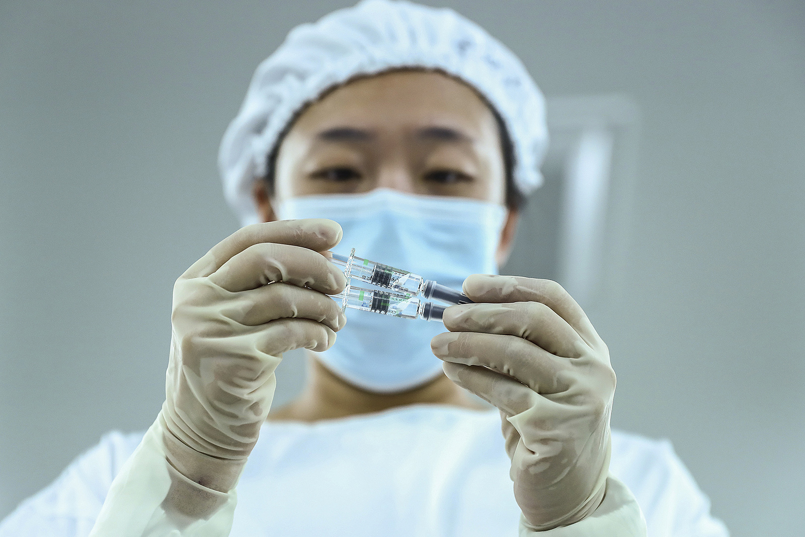 A staff member inspects syringes of Covid-19 inactivated vaccine products at a packaging plant of the Beijing Biological Products Institute Co., Ltd, a unit of state-owned Sinopharm, in Beijing.