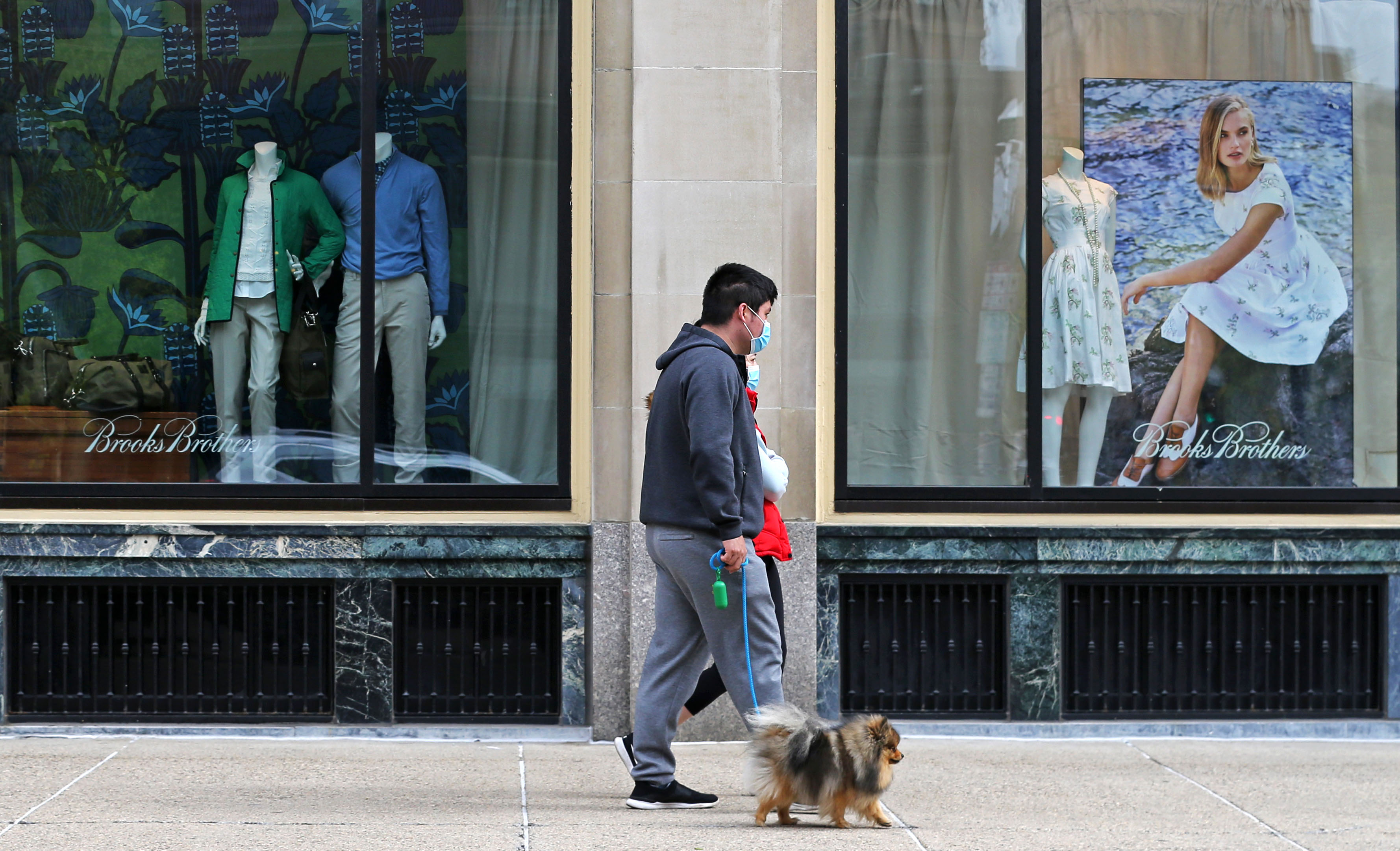 People walk past a Brooks Brothers store in Boston on May 11.
