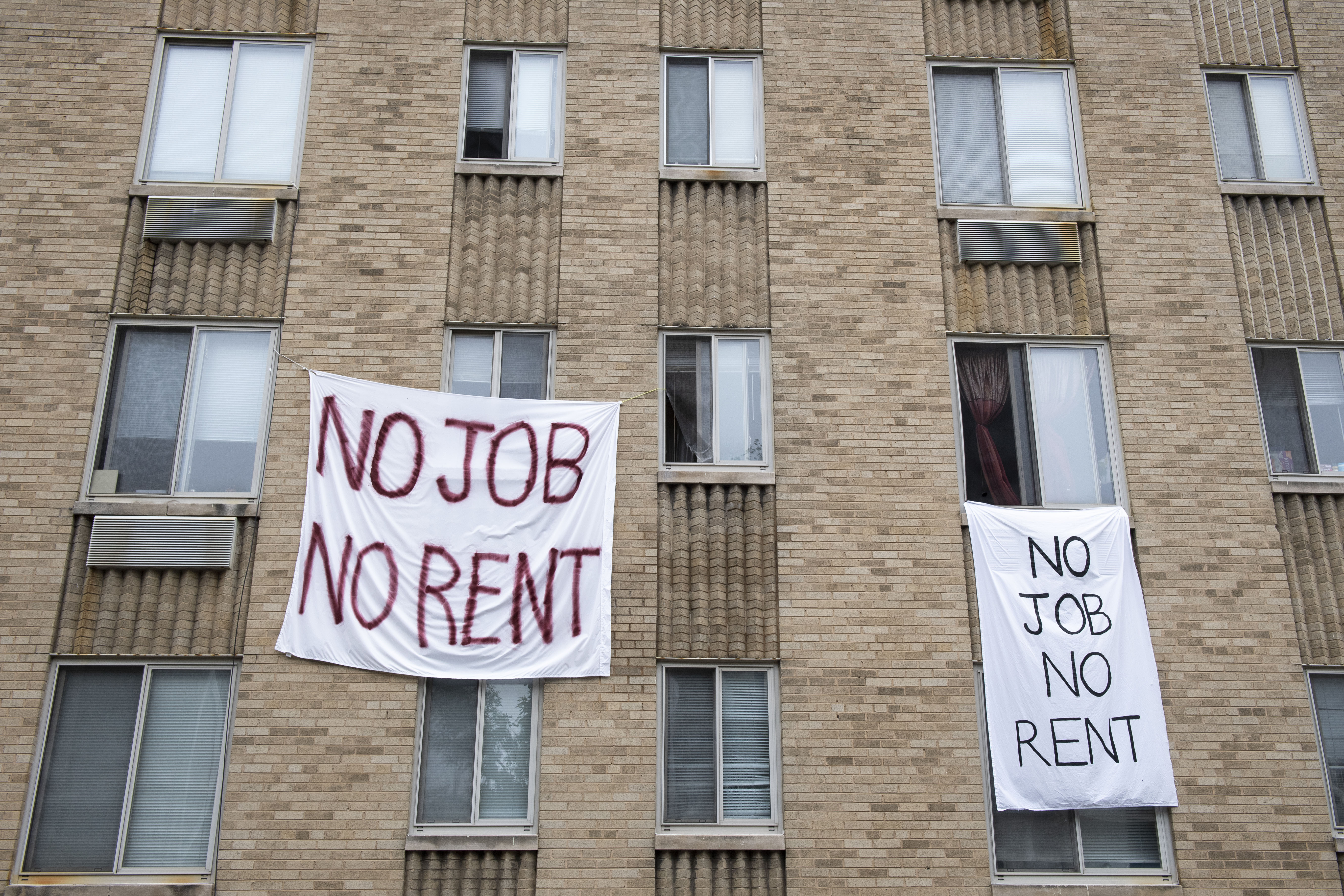 Signs hang from an apartment building in Washington on May 18.