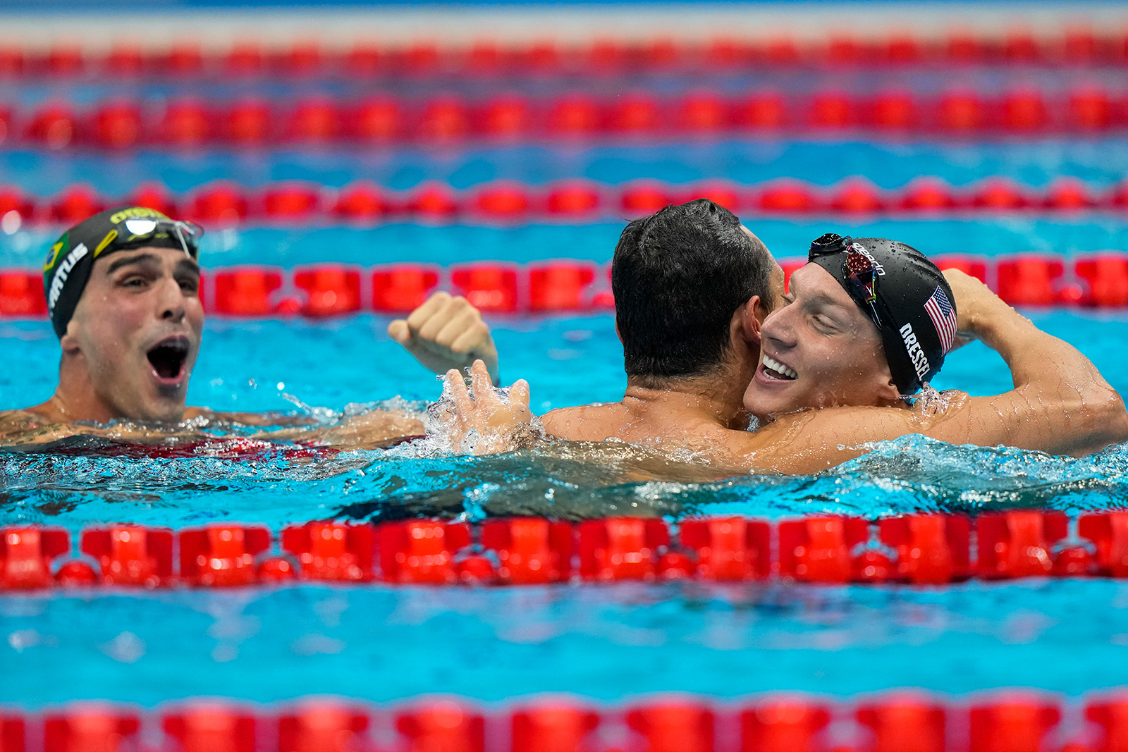 American swimmer Caeleb Dressel celebrates after winning the gold medal in a men's 50 meter freestyle on Sunday.