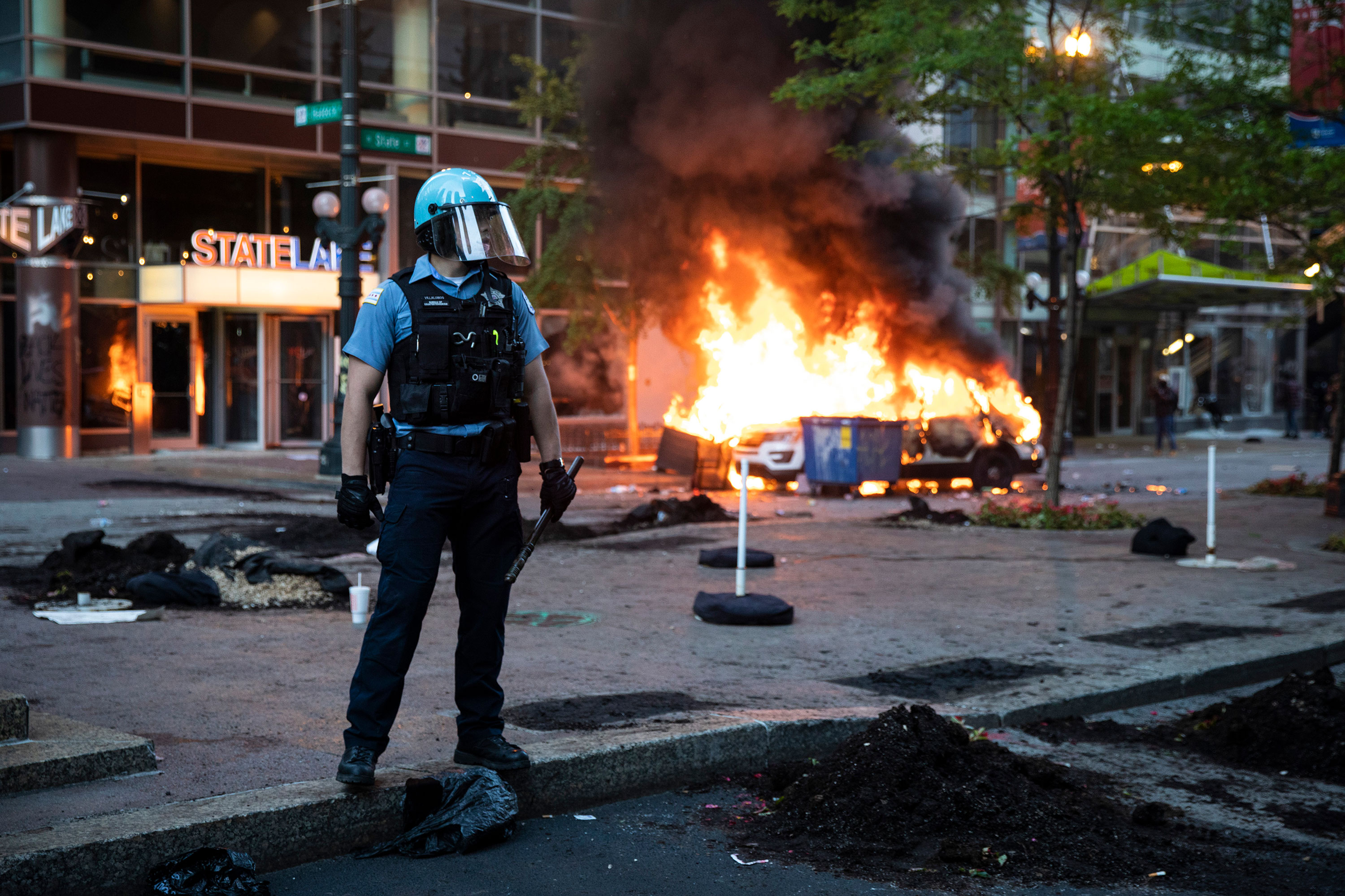 A Chicago Police Department SUV burns near State and Lake in the Loop in Chicago on May 30.