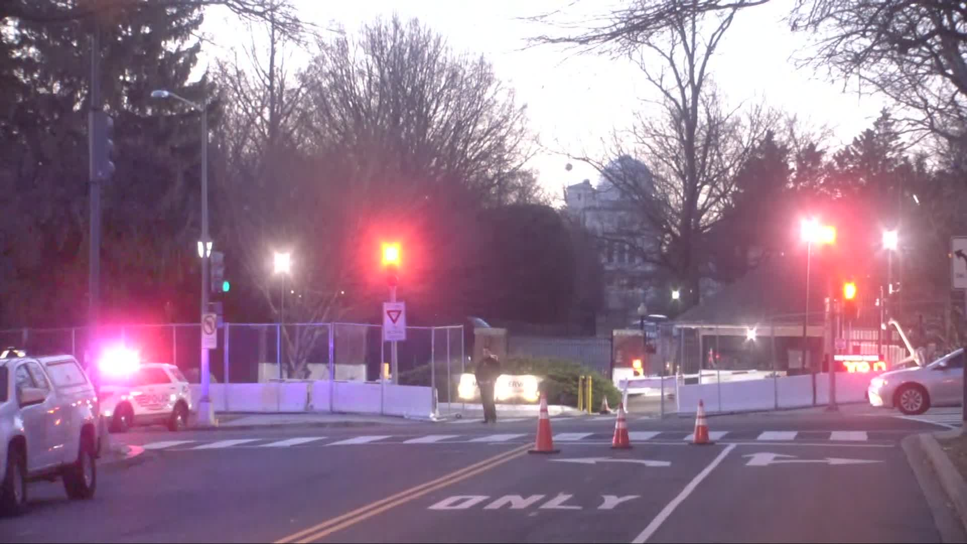 Security barriers are seen around the vice president's residence, the US Naval Observatory, in Washington, DC, on January 13, in this screengrab taken from CNN footage.