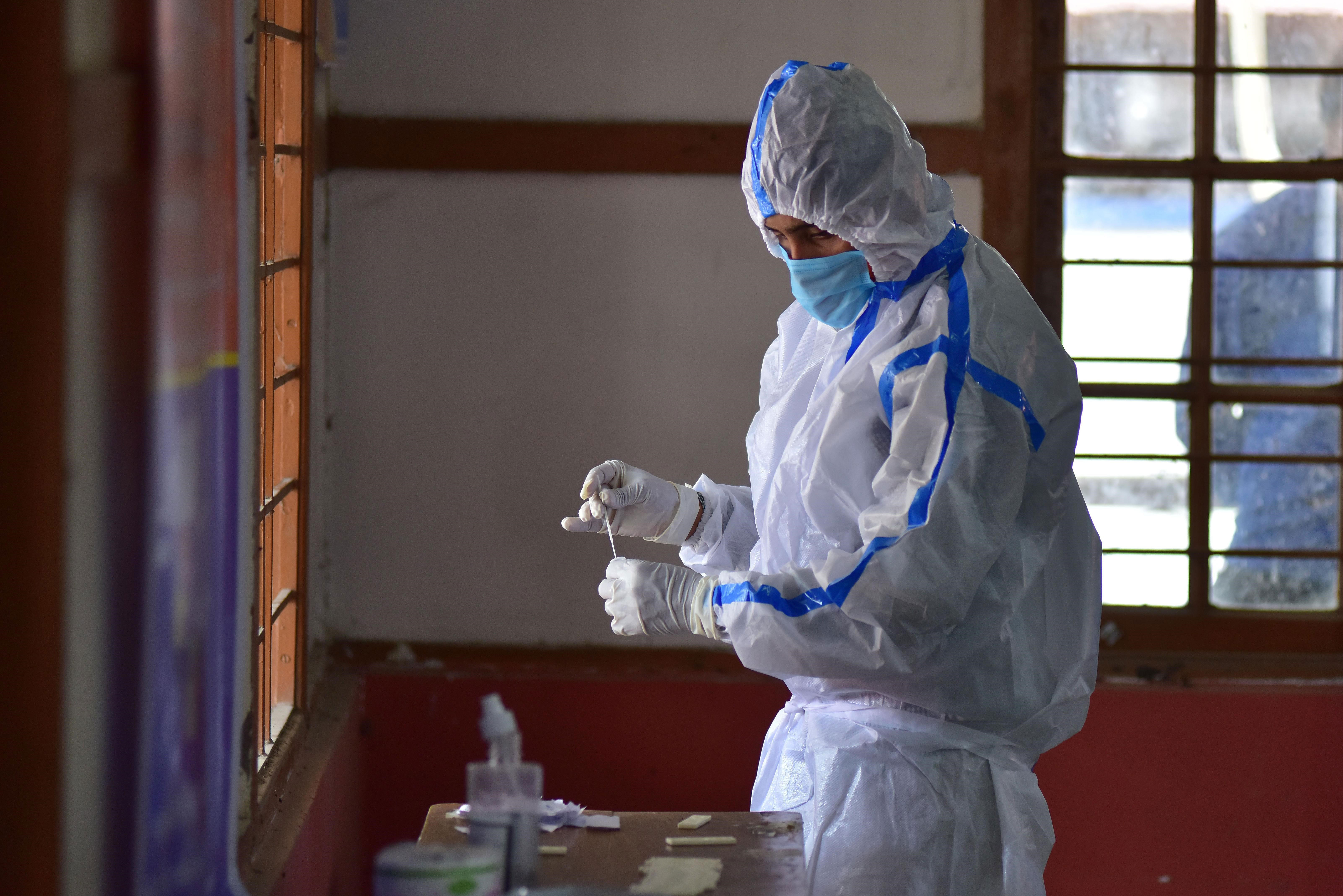A health worker conducts a rapid antigen test for Covid-19 in Nagaon, India, on May 27.