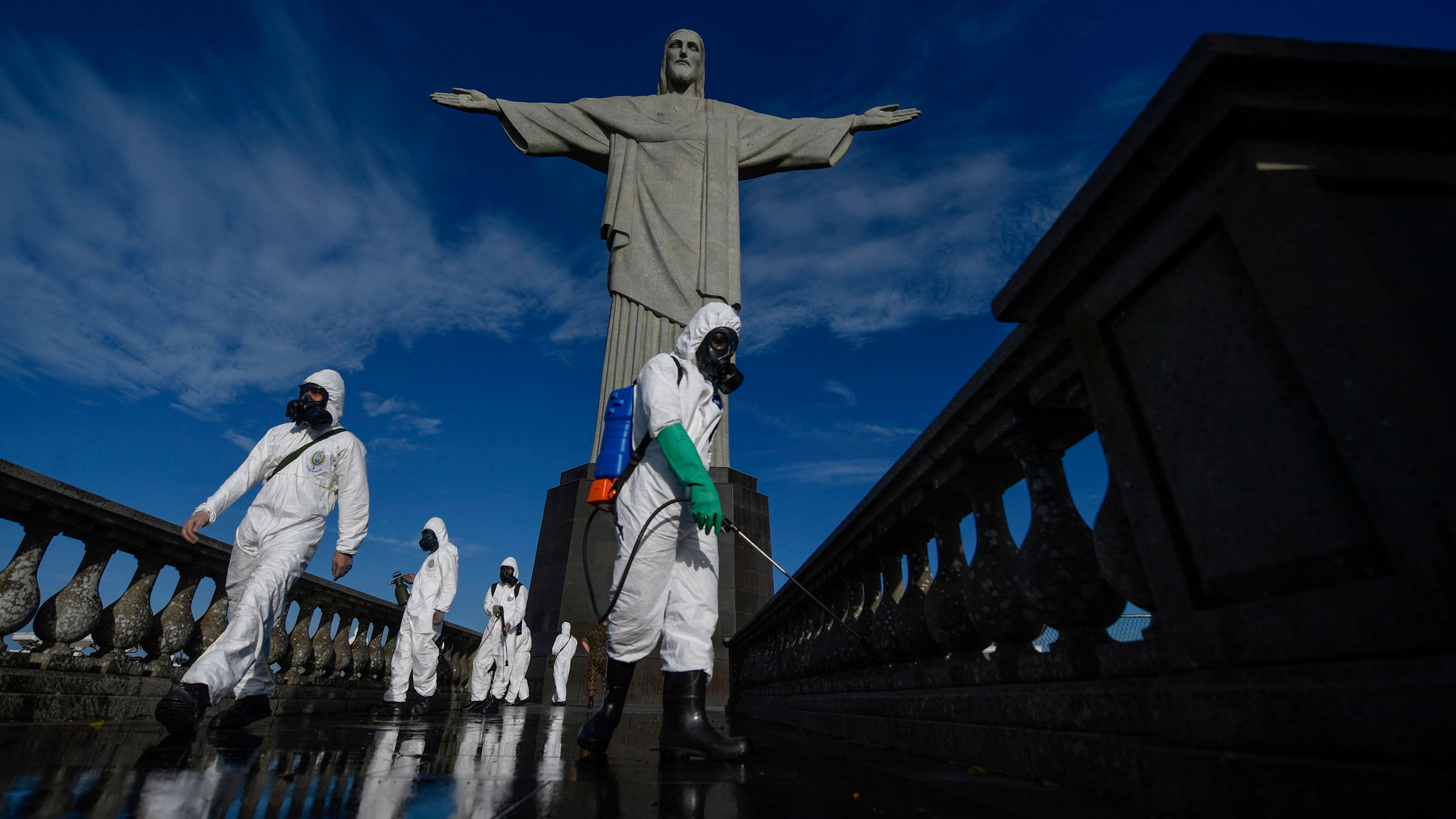Brazilian soldiers disinfect the area around the Christ the Redeemer statue Thursday in Rio de Janeiro.