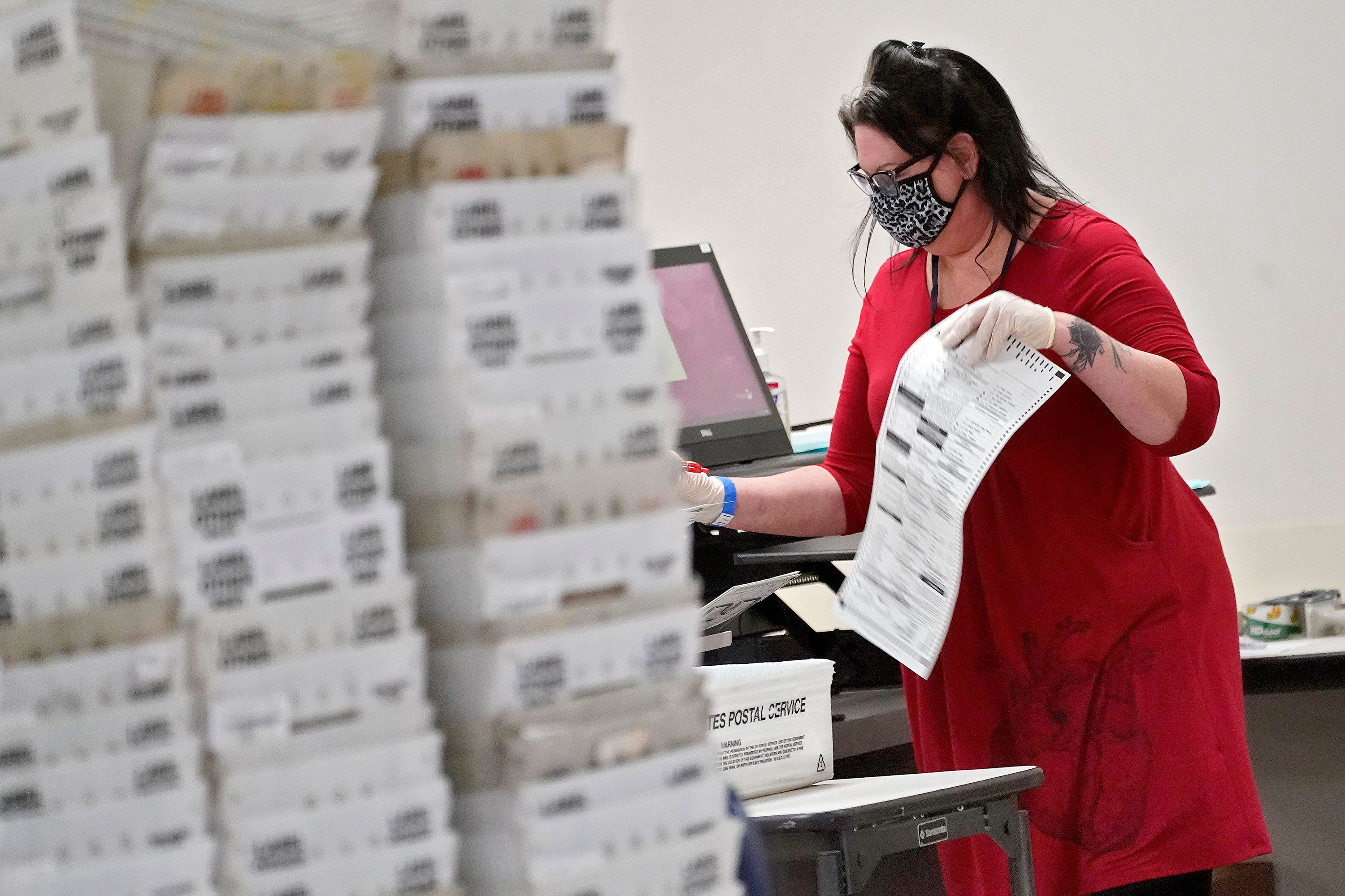 An election official counts ballots inside the Maricopa County Recorder's Office on Friday, November 6 in Phoenix, Arizona.